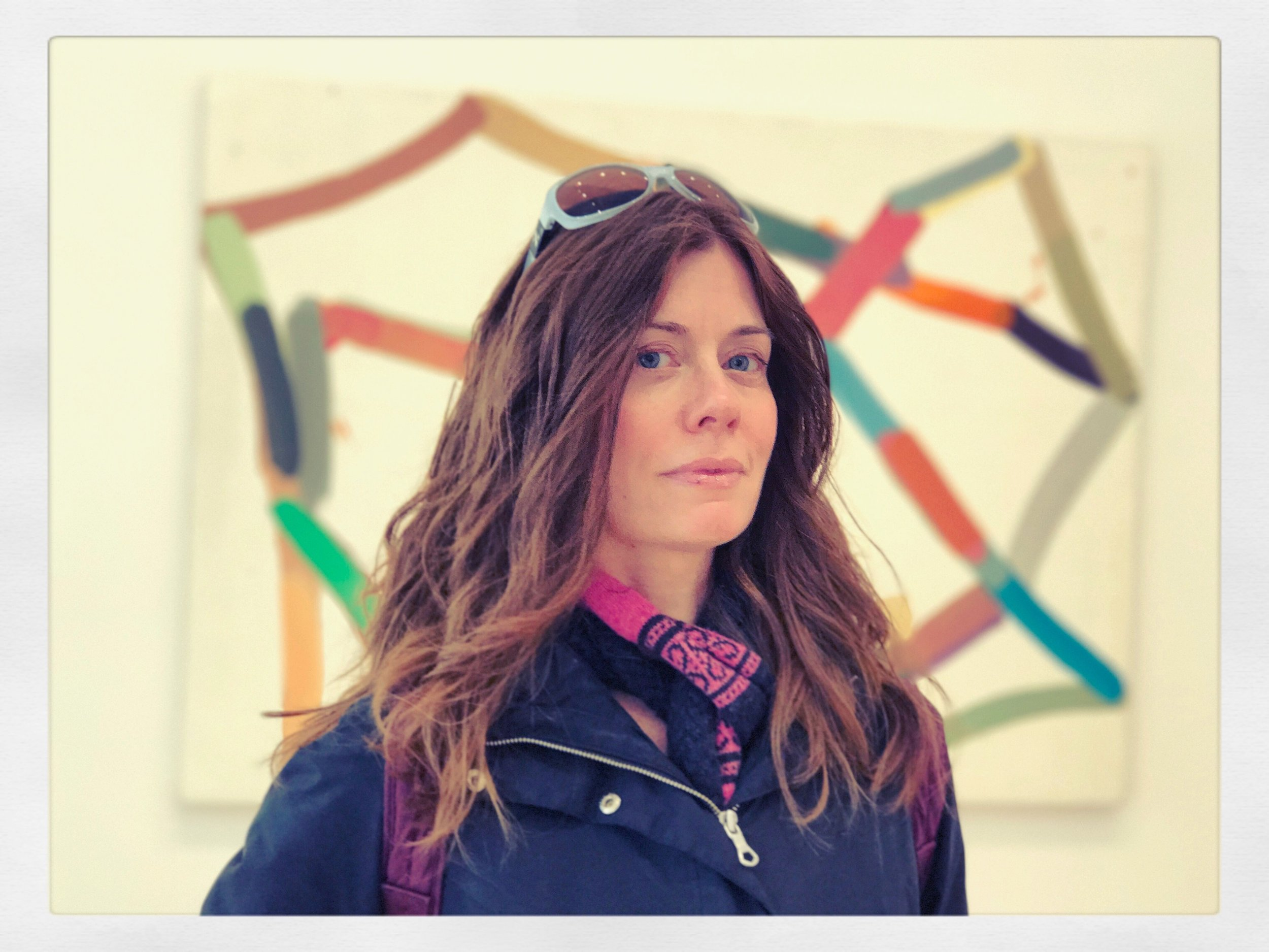Standing in front of an Al Taylor painting in Chelsea, 2017. Photo: Ellen Papazian