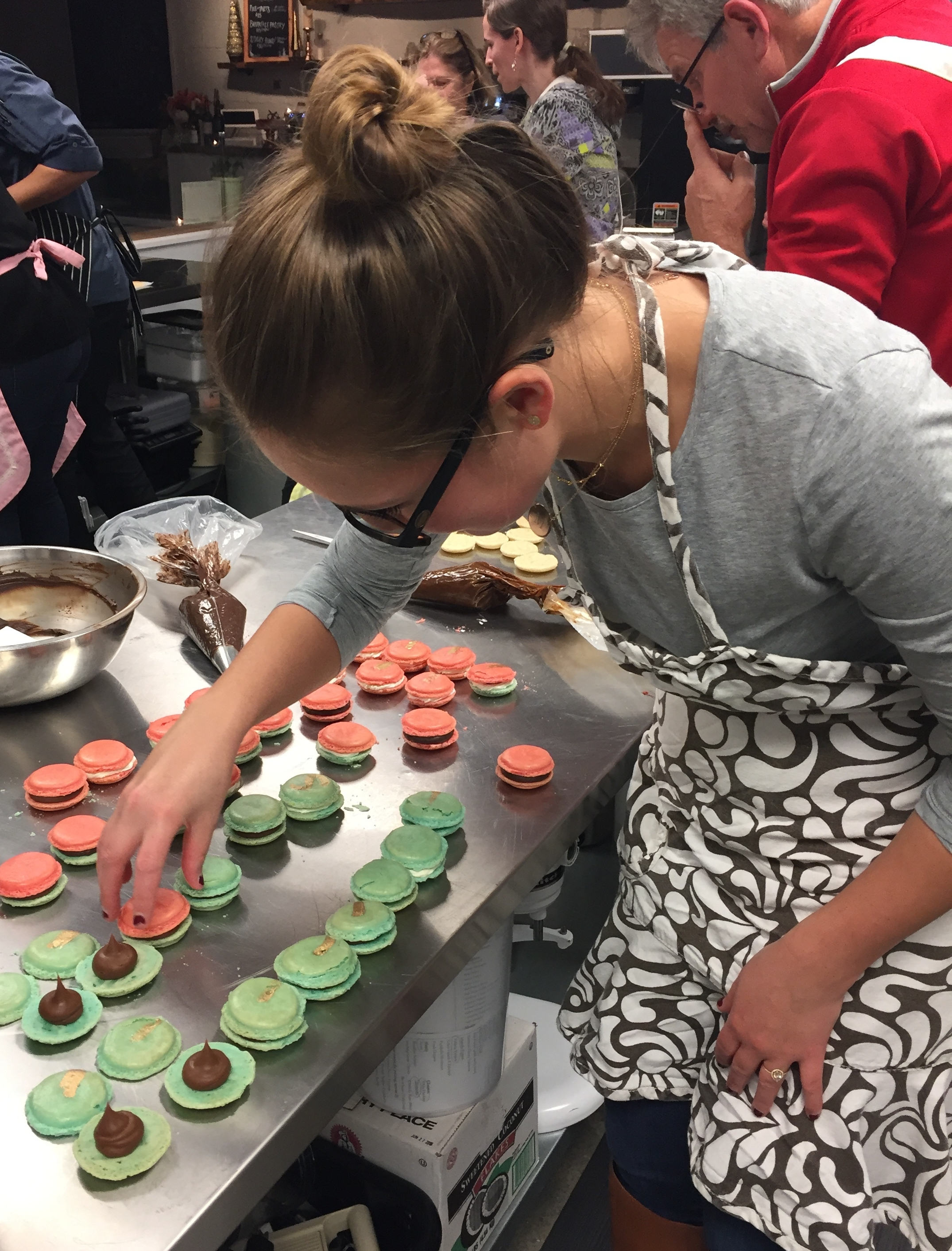 Martha Stuart (my sister) working her magic as she finishes off a dozen macarons.