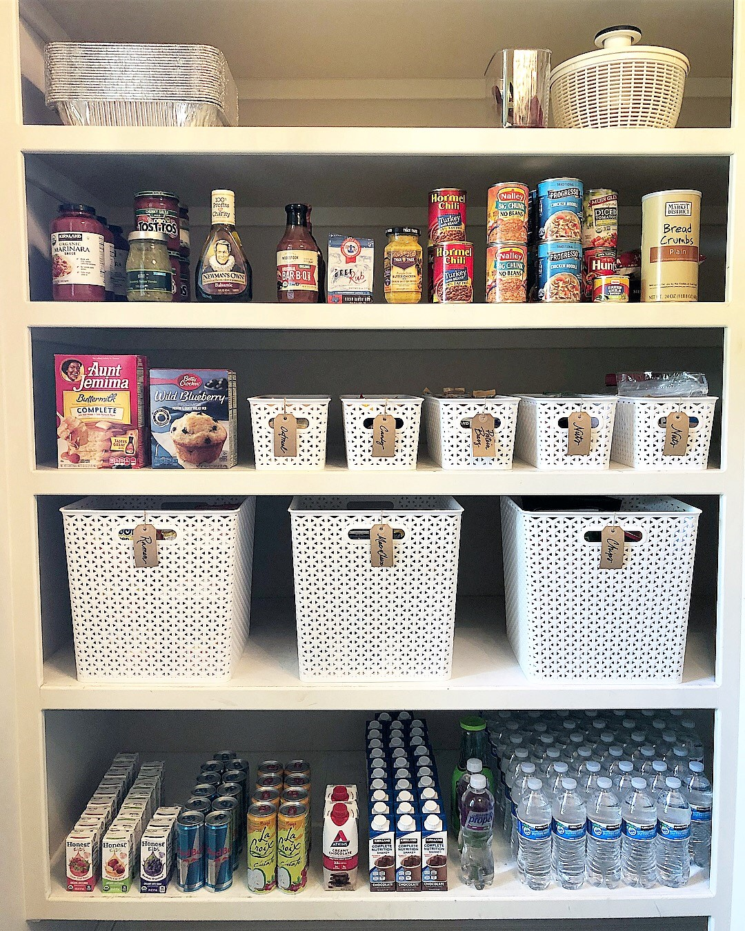 """Baskets contain each """"zone"""" in this walk-in pantry."""