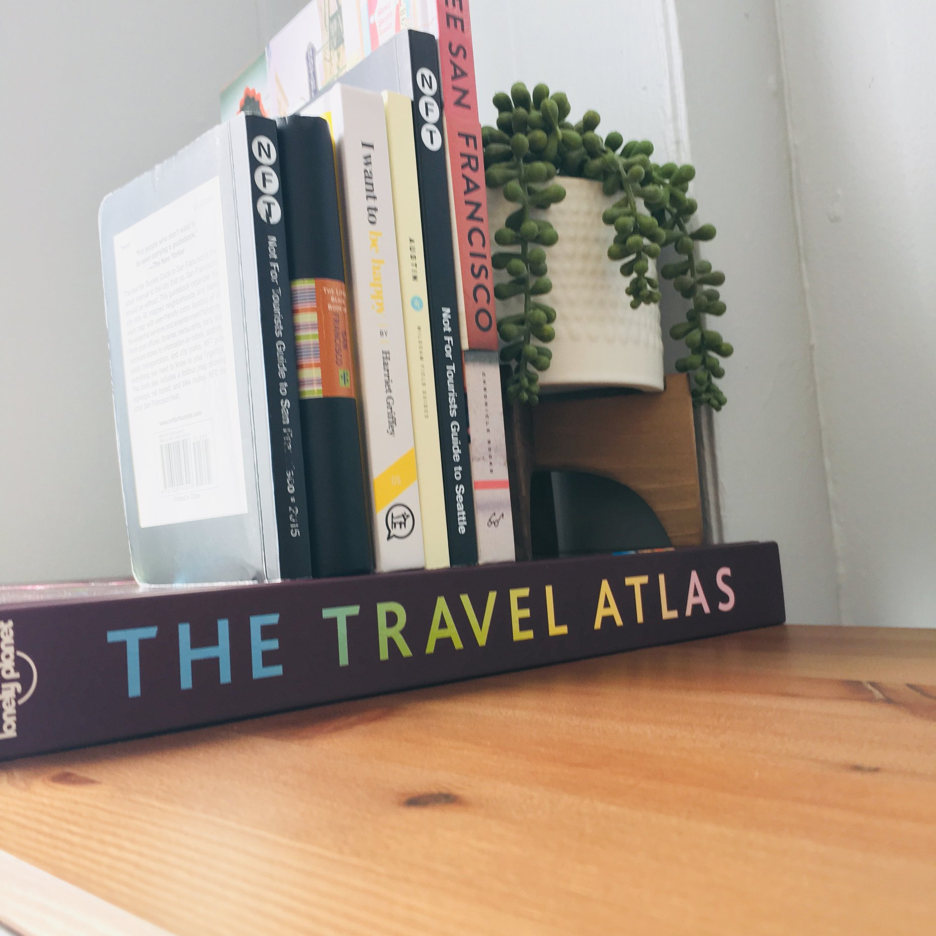 Crystal + Chad's Collection of Travel Books, featuring some of their favorite destinations. | Photo Credit: C. Starns / C. Grave