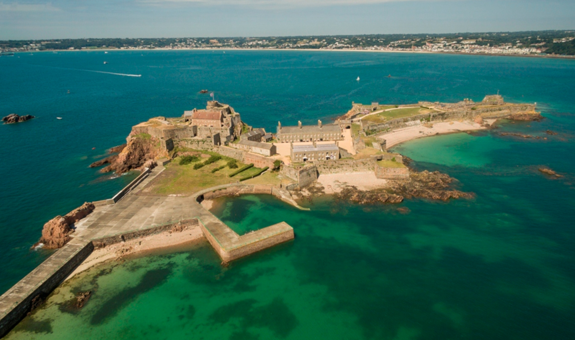 Elizabeth Castle (photo via Jersey.com) just a ferry ride off of Jersey Island to get to this stunning tudor castle.