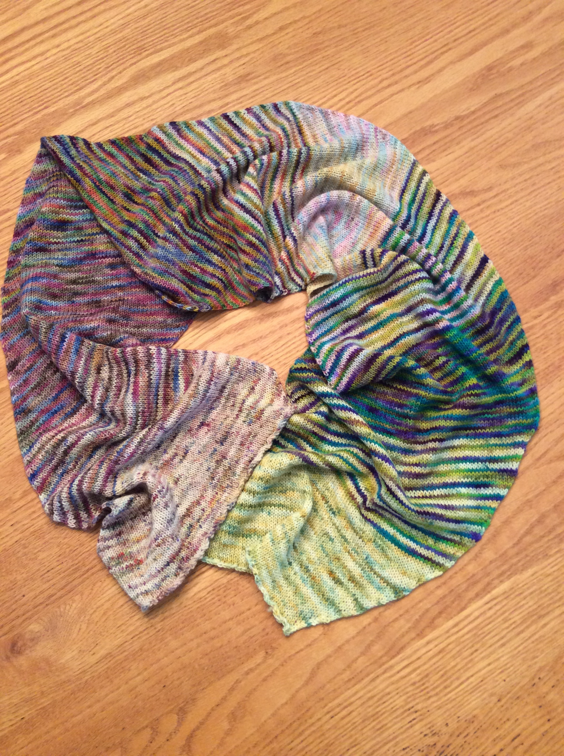 Betsy - Here is my Annalise Shawl made with 5 colors of Koigu (p118/406, p335, p118/137, p105, p819, p509).Easy pattern but tough choosing colors. I have seen it done in other colorways and doubt you can go wrong with anything you select or how you sequence them. As usual with my Koigu items, the compliments just keep coming.