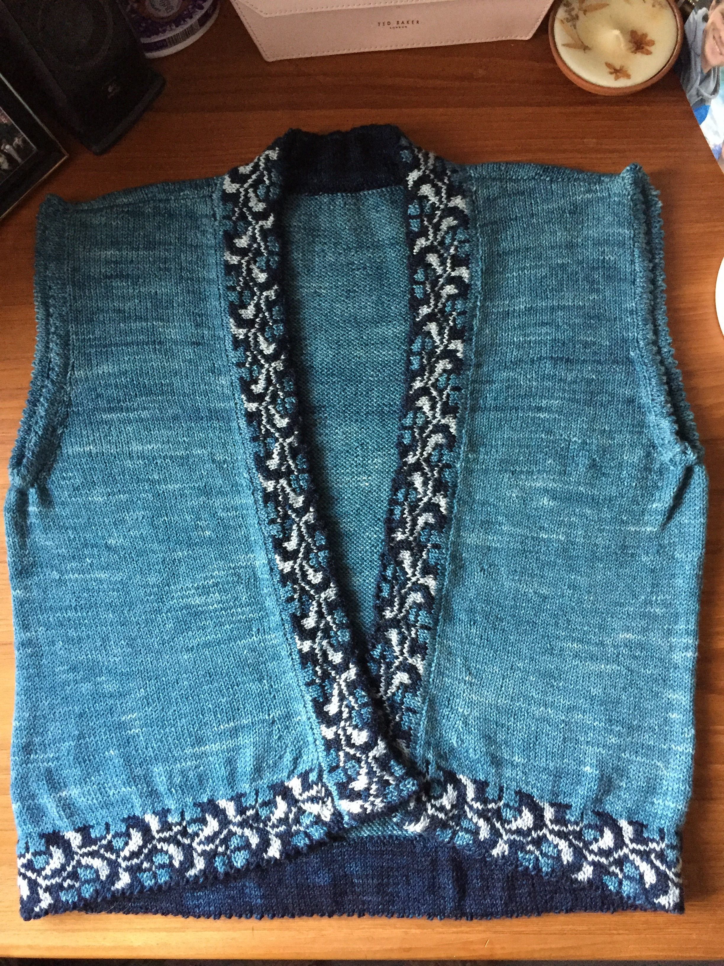 Janice - Norweign vest entitled Ambrosia Vest using KPPPM for upcoming knitting cruise along the coast of Norway. Lots of steeking and finishing of bands with picot edging.