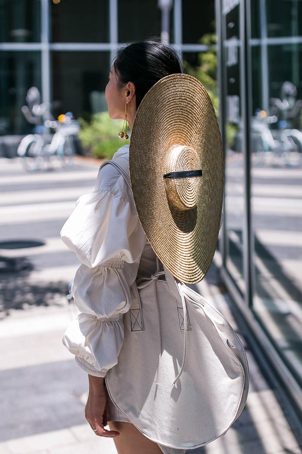 Jacquemus-flat-top-straw-hat.jpg