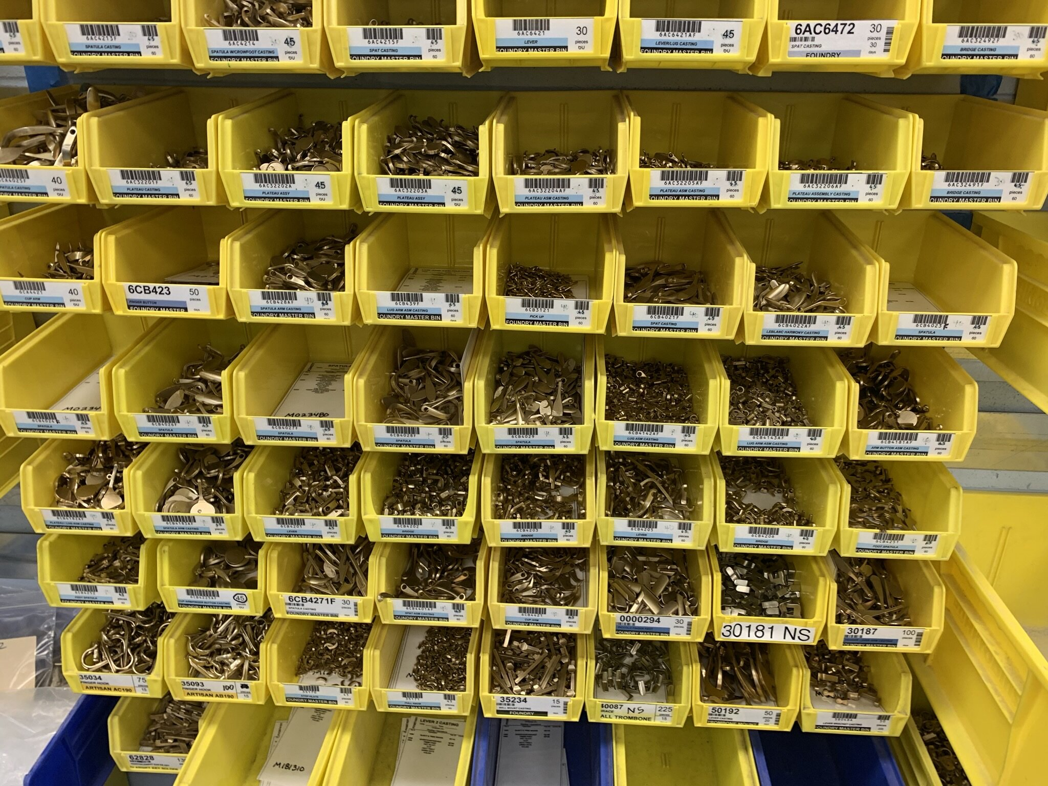 Bins of keys are organized and catalogued for each woodwind family.
