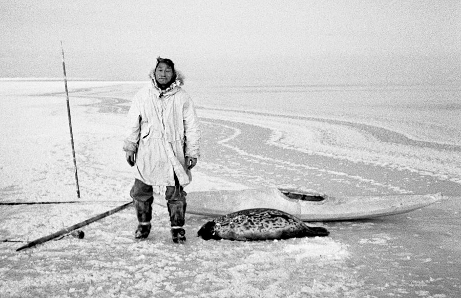 The late Andrew Ekak with his kayak, used for retrieving a seal shot in an open lead far offshore from Wainwright, on the Arctic Coast (1965 photo).