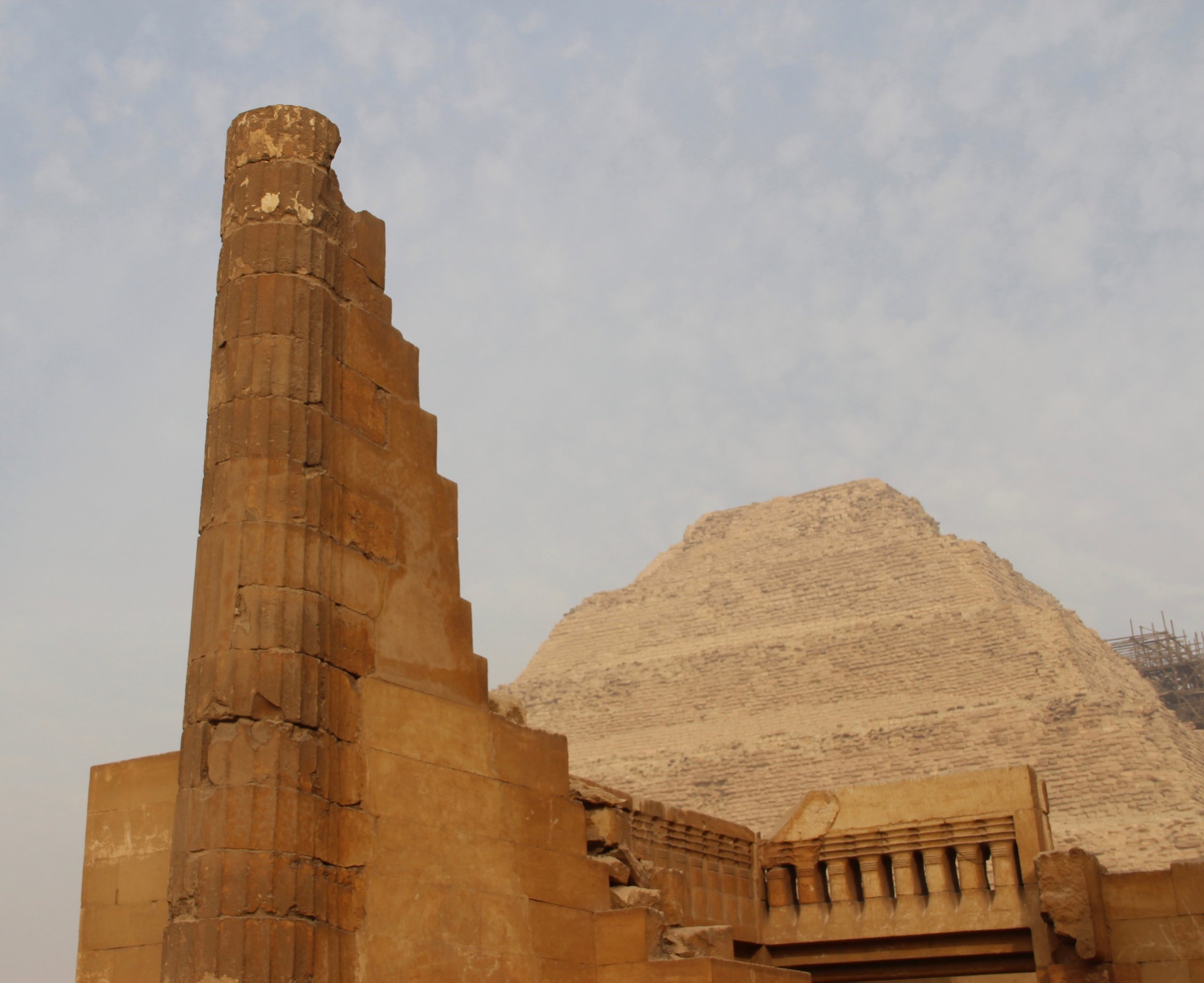 Dramatic columns and detailed balustrades surround the Step Pyramid