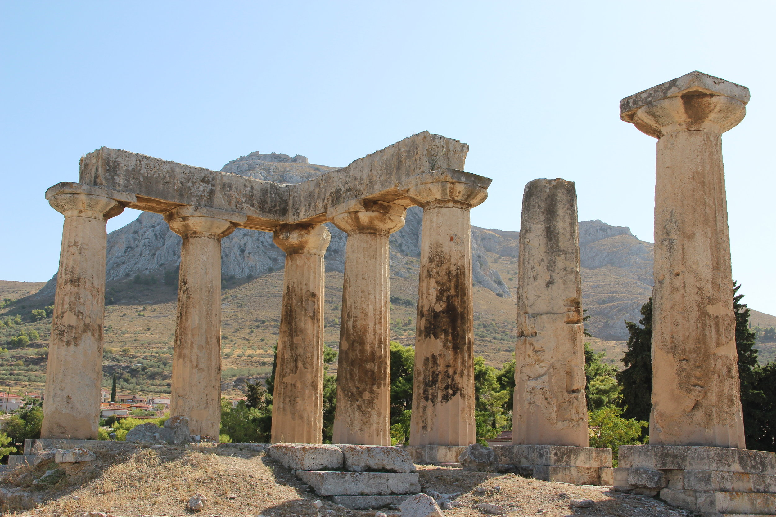 The ancient Greek temple of Athena in the archeological site of Corinth, below Acrocorinth