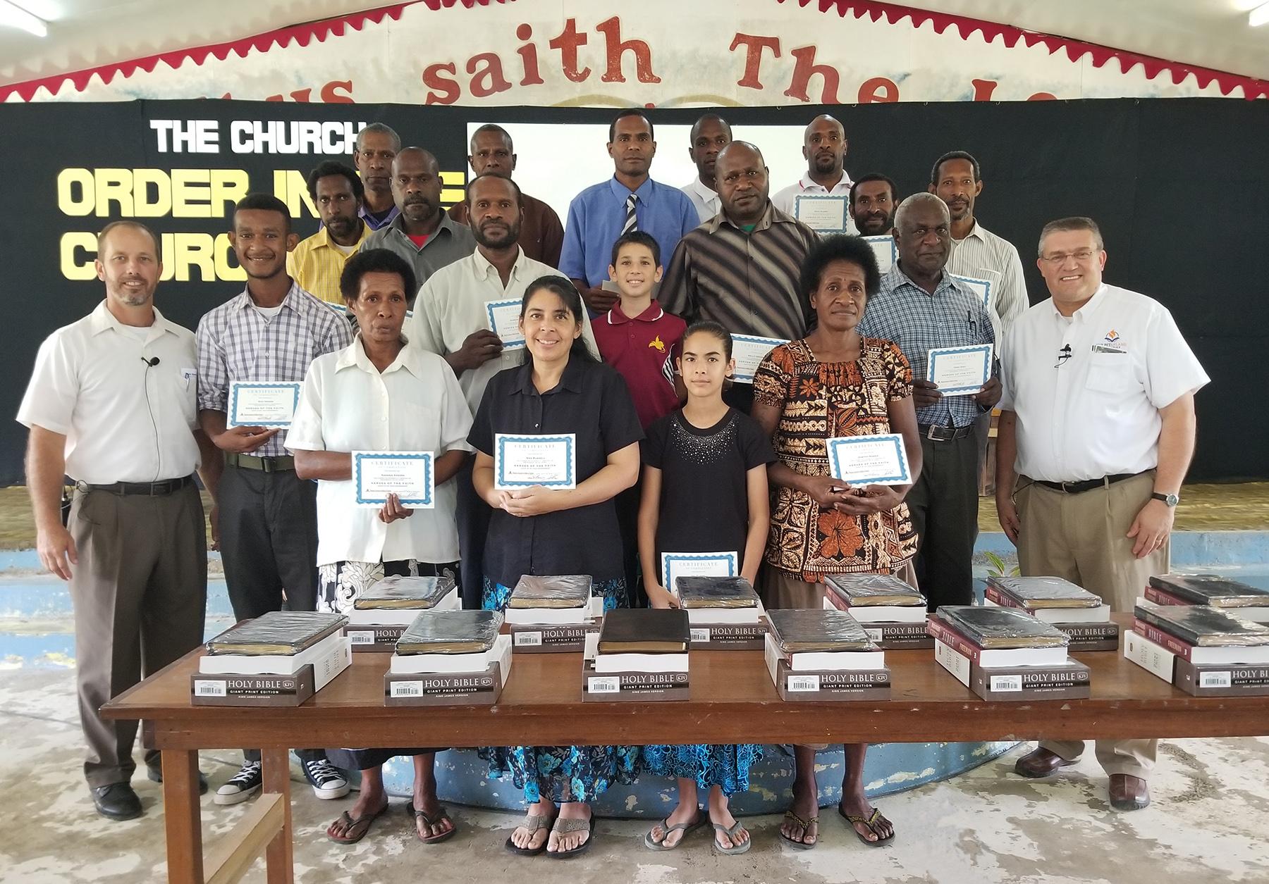 Missionary Jason Russell, Dr. Doug Brandenburg and the students of Daru Baptist Bible School