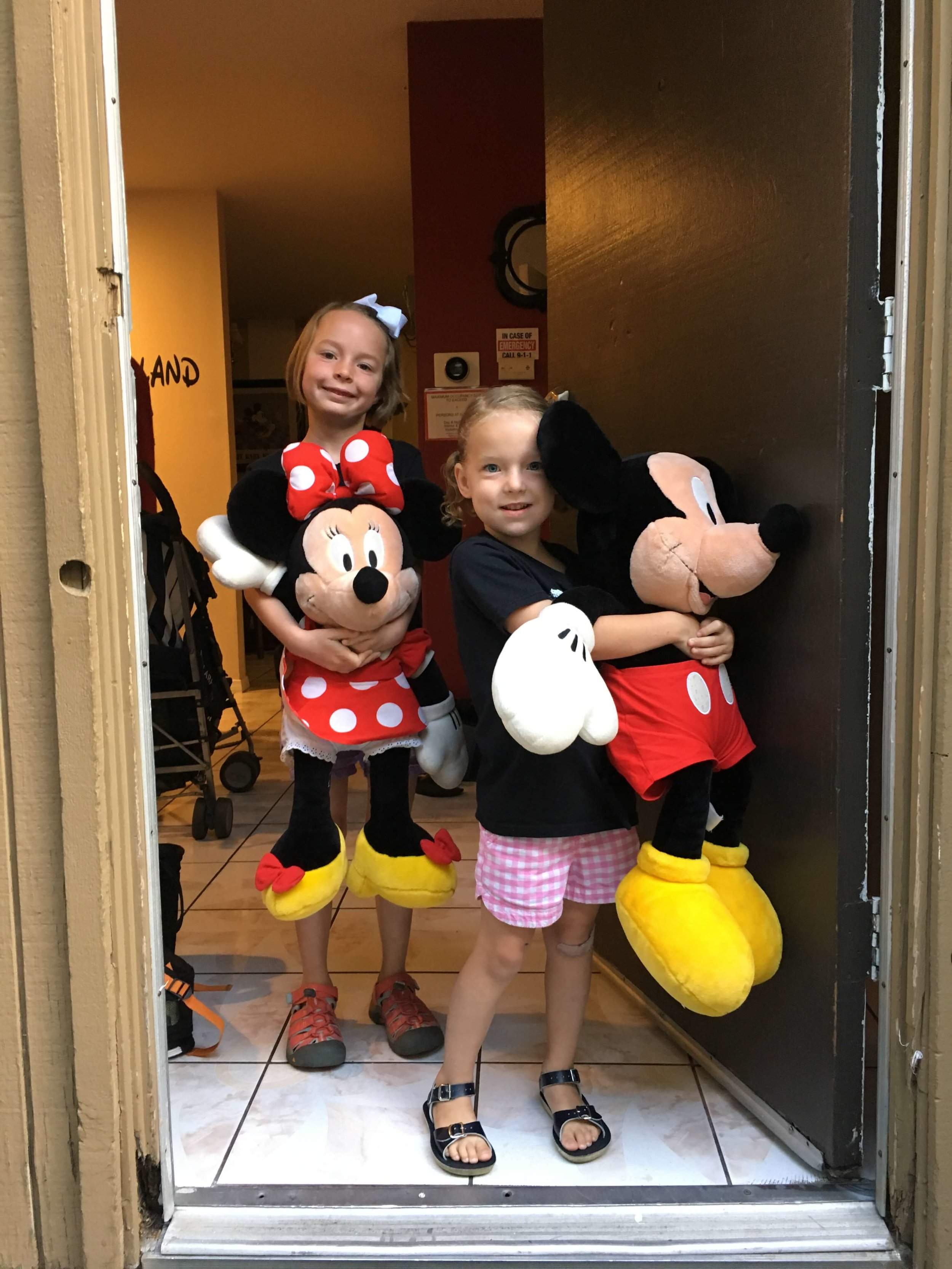 Bonus: massive plush Mickey and Minnie to play with.