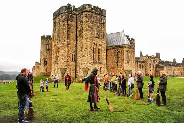 "Who wouldn't like a little ""broomstick training"" on the same spot as Harry Potter? _ Northumberland's Alnwick Castle checks in at #5 on our list of our favorite castles in England (🔗 in profile) has a long and pivotal history as the seat of the powerful Percy family.  In more recent times, it has served as the primary stand-in for Hogwarts in the early HP movies. _ No matter the kind of history you come for, Alnwick will put on a good show for the entire family (the eagle-eyed can spot all three of our kids holding a broom in the picture above). If you need another excuse to visit, Alnwick is home to one of England's best gardens."