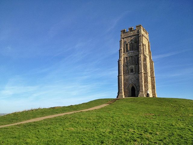 The remaining tower of the medieval St. Michael's Church looks out over the West Country from its commanding position on Glastonbury Tor. _ This site with historic and legendary (Glastonbury Tor has strong ties to Arthur and Merlin) significance makes a great stop on another one of our favorite day trips from London (🔗 in profile). _ The trip out to this part of Somerset takes a while, but you're rewarded with visits to Glastonbury (a quirky town with a nice ruined abbey to complement the walk up The Tor) and Wells (a charming small city with a wonderful cathedral).