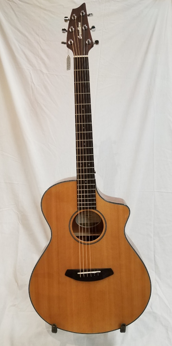 """Breedlove Concert Discovery CE Guitar   Featuring a lovely Sitka spruce and mahogany body, this guitar also includes an integrated Fishman pickup with auxiliary tuner. Run a cable from the 1/4"""" jack to your favorite amp and your own acoustic sound can fill the hall."""
