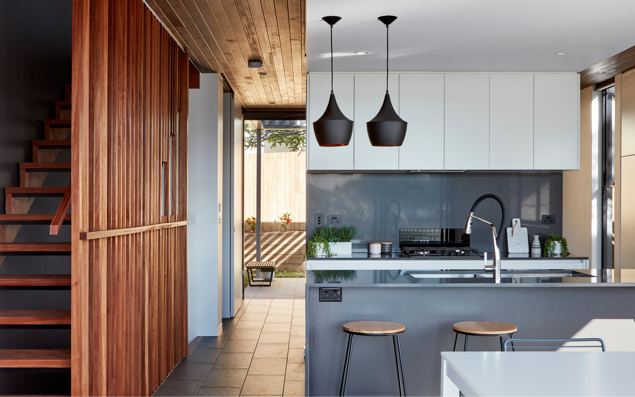 Shades of grey with white joinery are complimented by stained timber.