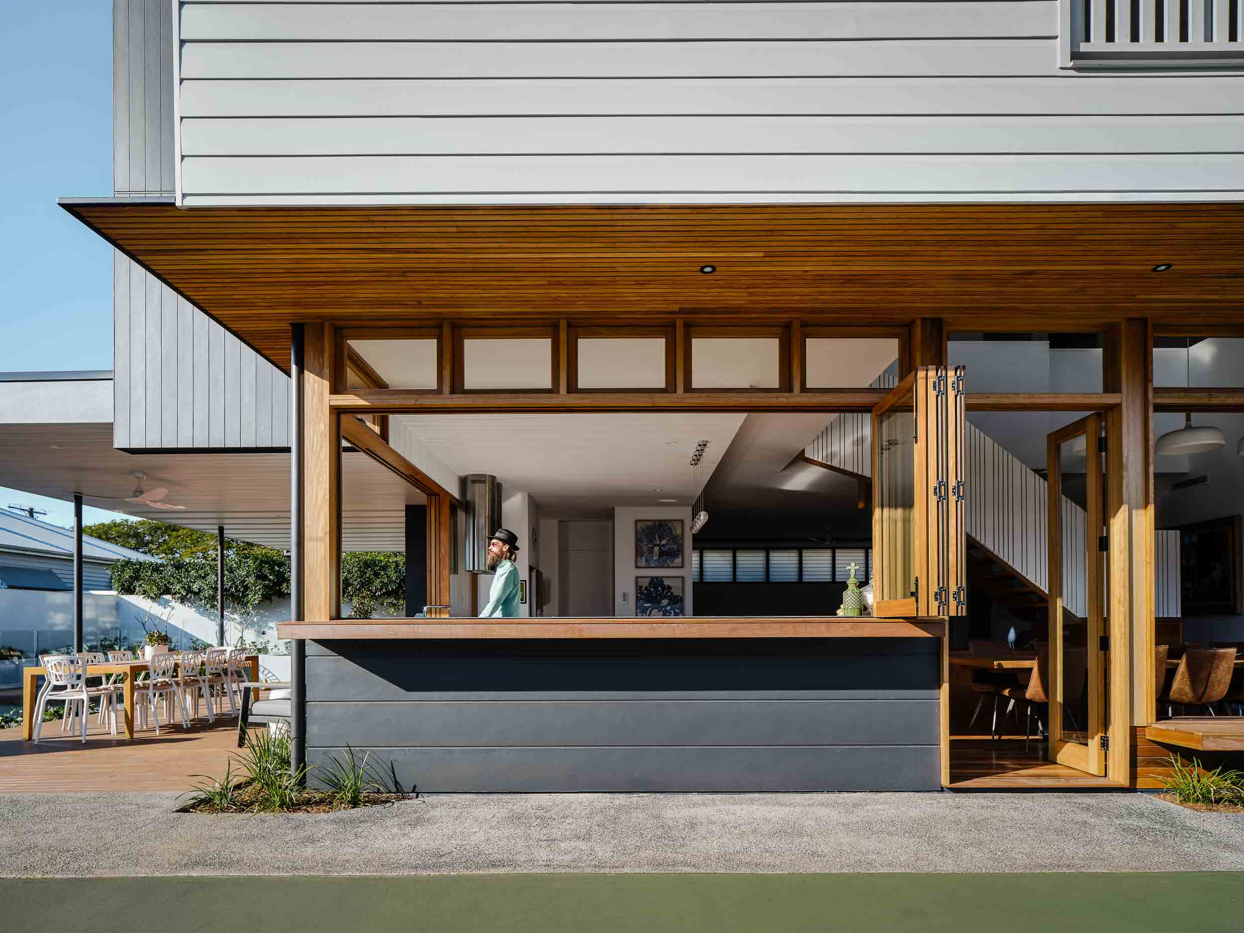 The kitchen dining area opens to the pool and tennis court and functions as 'The Centre Court""