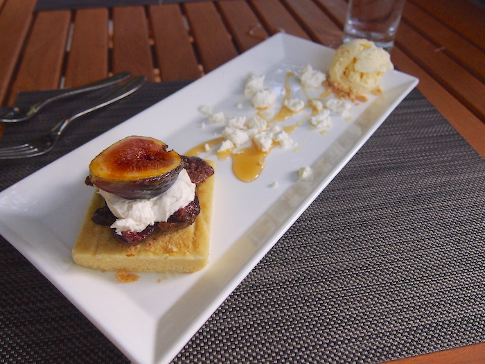 Figs and mascarpone over cake with goat cheese, and goat cheese ice cream drizzled with honey.