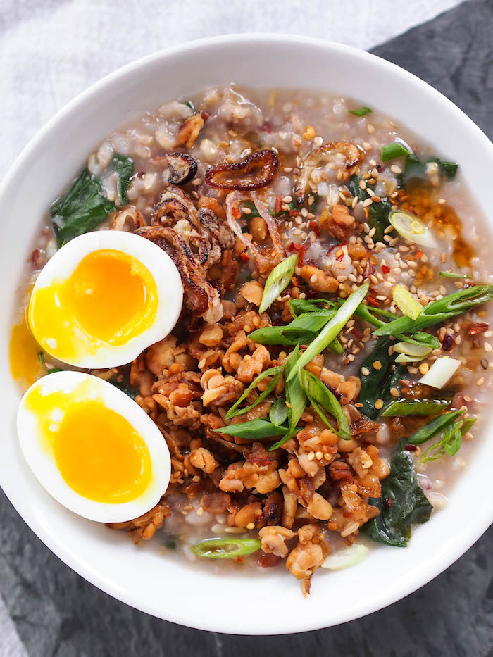 Congee is a savory Asian rice porridge served for breakfast! Gluten free and vegan if you leave off the egg!