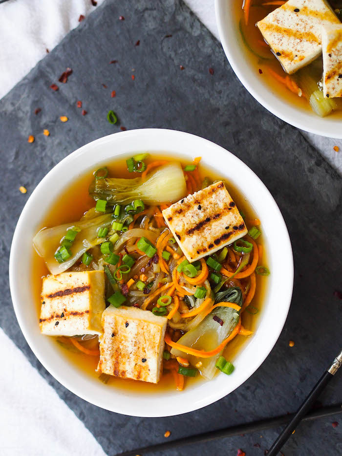 This gluten free Asian veggie noodle soup with tofu uses spiralized zucchini and sweet potatoes in place of wheat noodles!