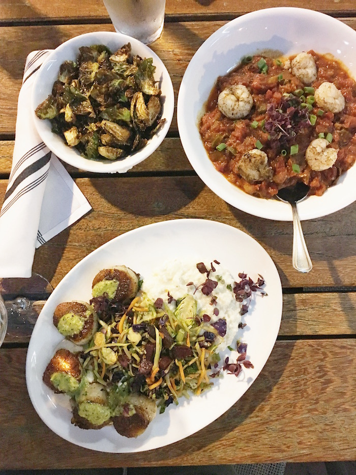 Crispy brussels sprouts, eggplant jambalaya, and scallops with creamy rice grits, salsa verde and roasted beets