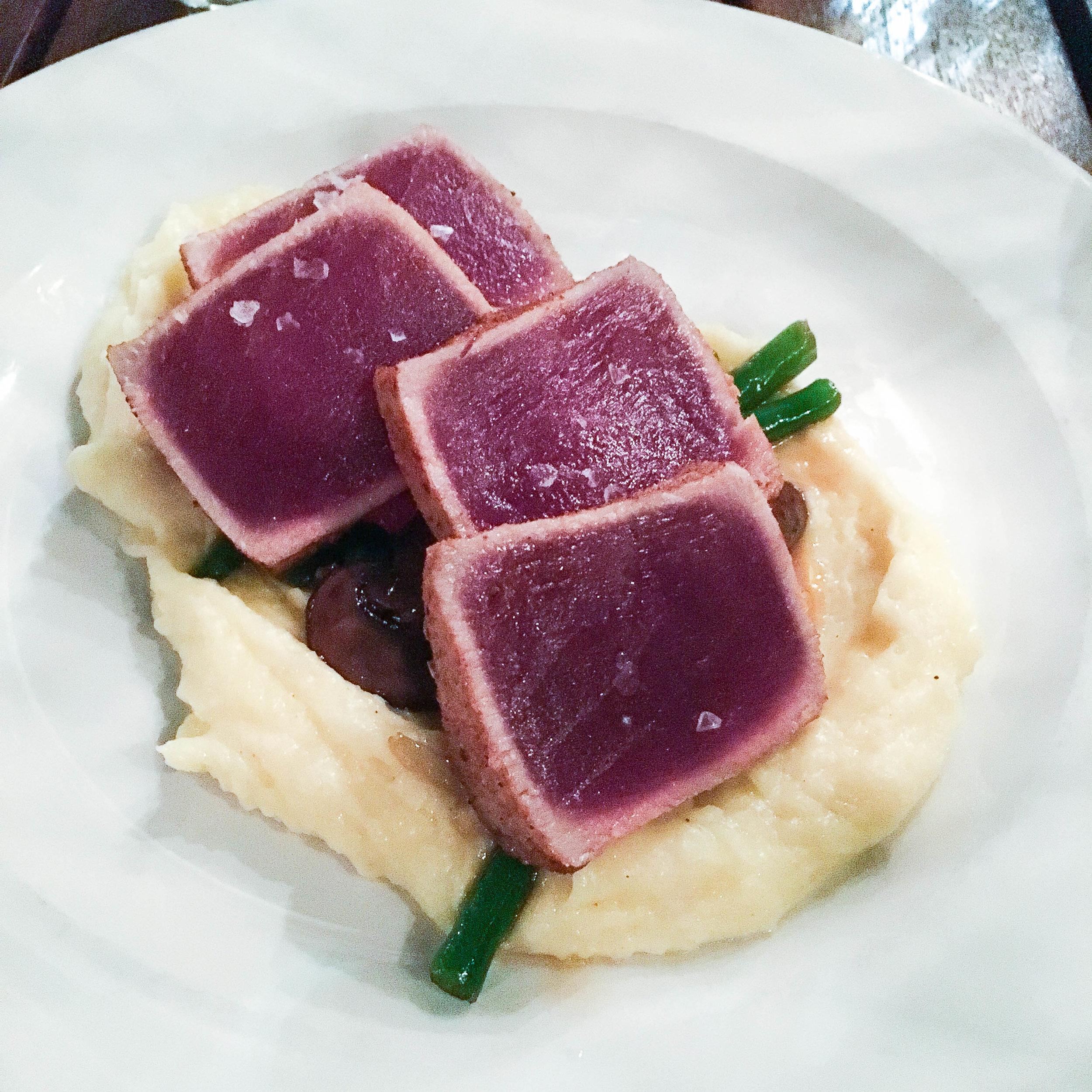 Seared tuna loin with mashed potatoes, mushrooms and succotash
