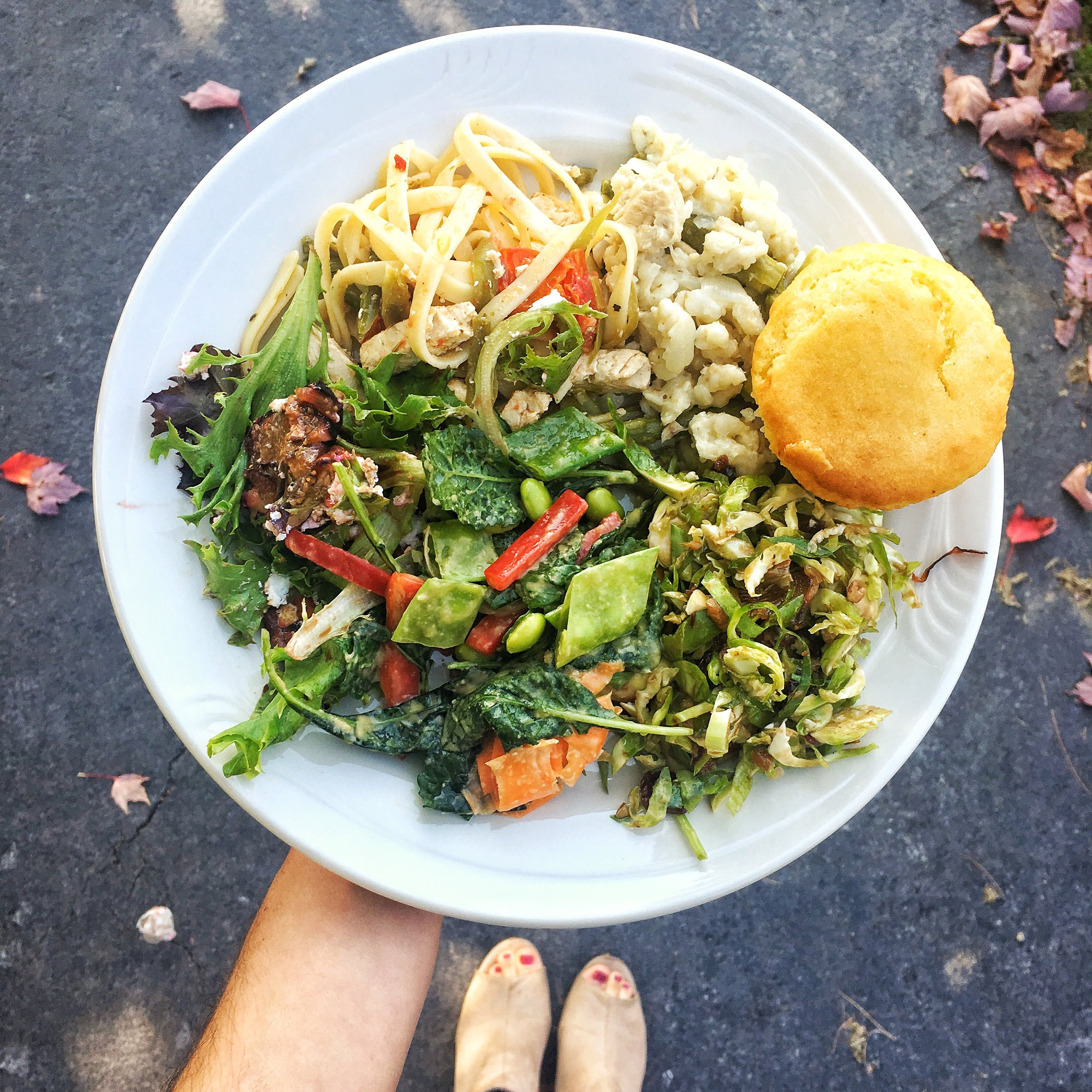 """Lemon linguine with MorningStar Farms """"chicken strips"""", tuna risotto, and three types of salad. The shaved Brussels sprouts salad with maple vinaigrette was obsession worthy."""