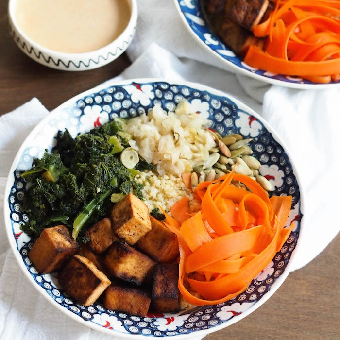 Sweet and Spicy Tofu Millet Bowl with Garlicky Kale and Citrus Tahini Sauce