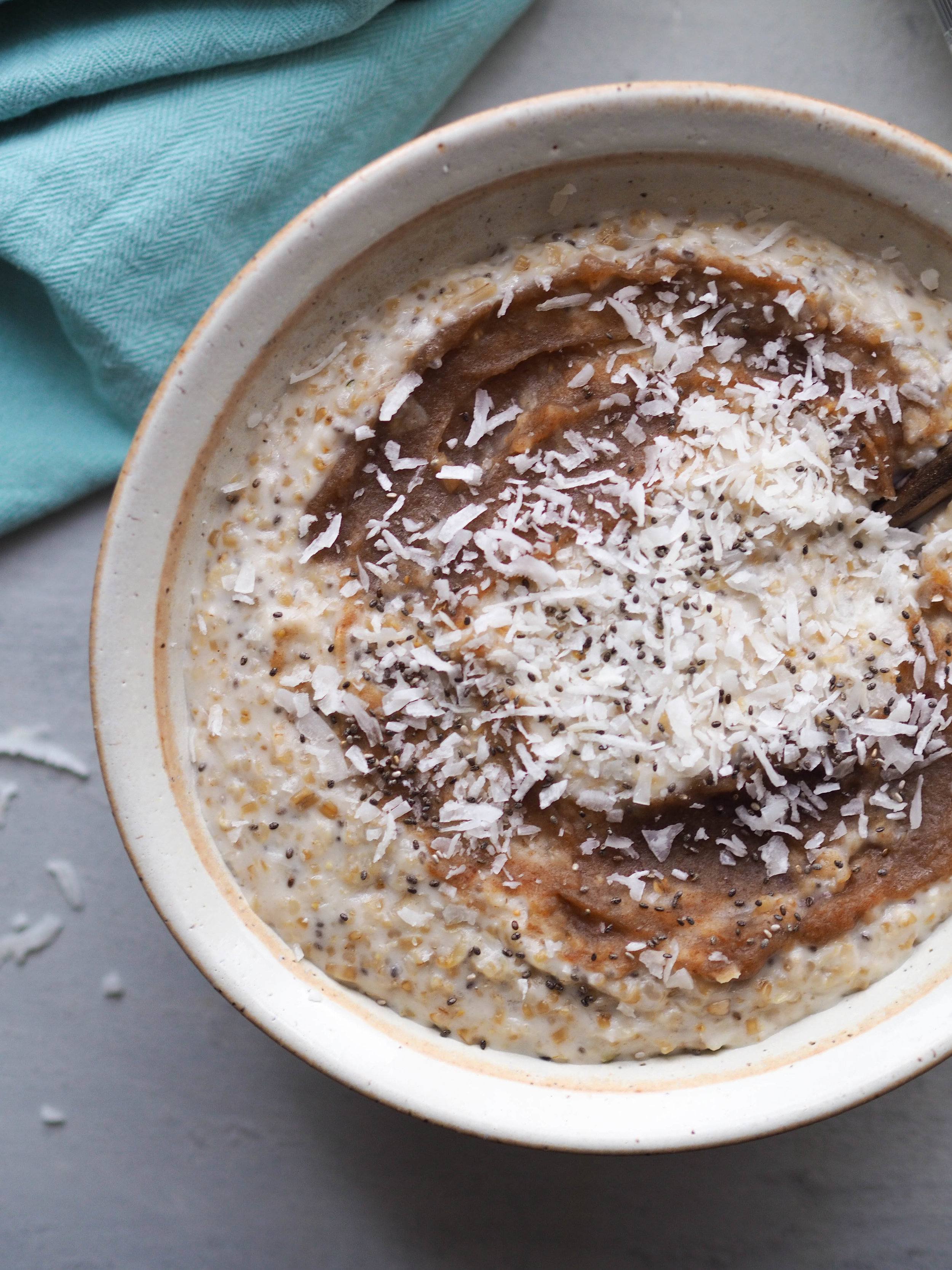 Steel cut oats get extra creamy with coconut milk in this recipe for coconut ginger date oatmeal!