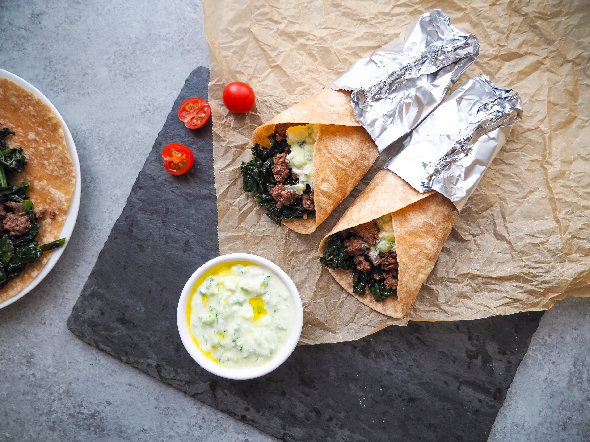 These Greek Tacos with Kale and Creamy Feta Sauce are SO good! Total comfort food! The creamy feta sauce just makes it! #taco #greek #kale