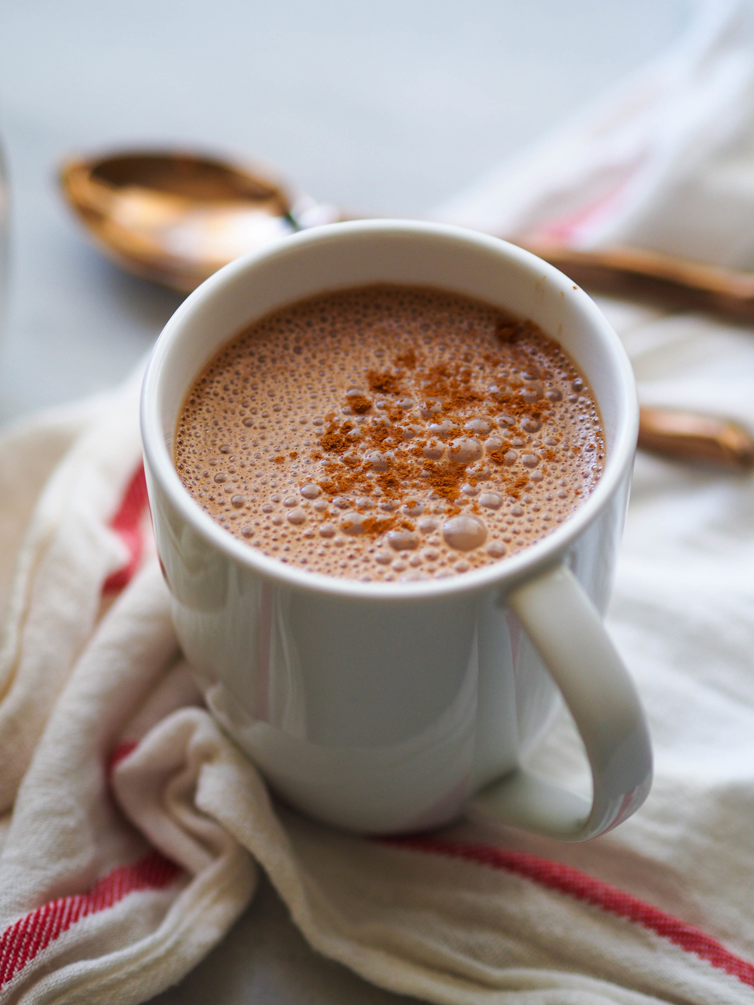 Make this frothy Mexican Hot Chocolate to warm up in the winter! #hotchocolate #chocolate #beverage #winter #vegan