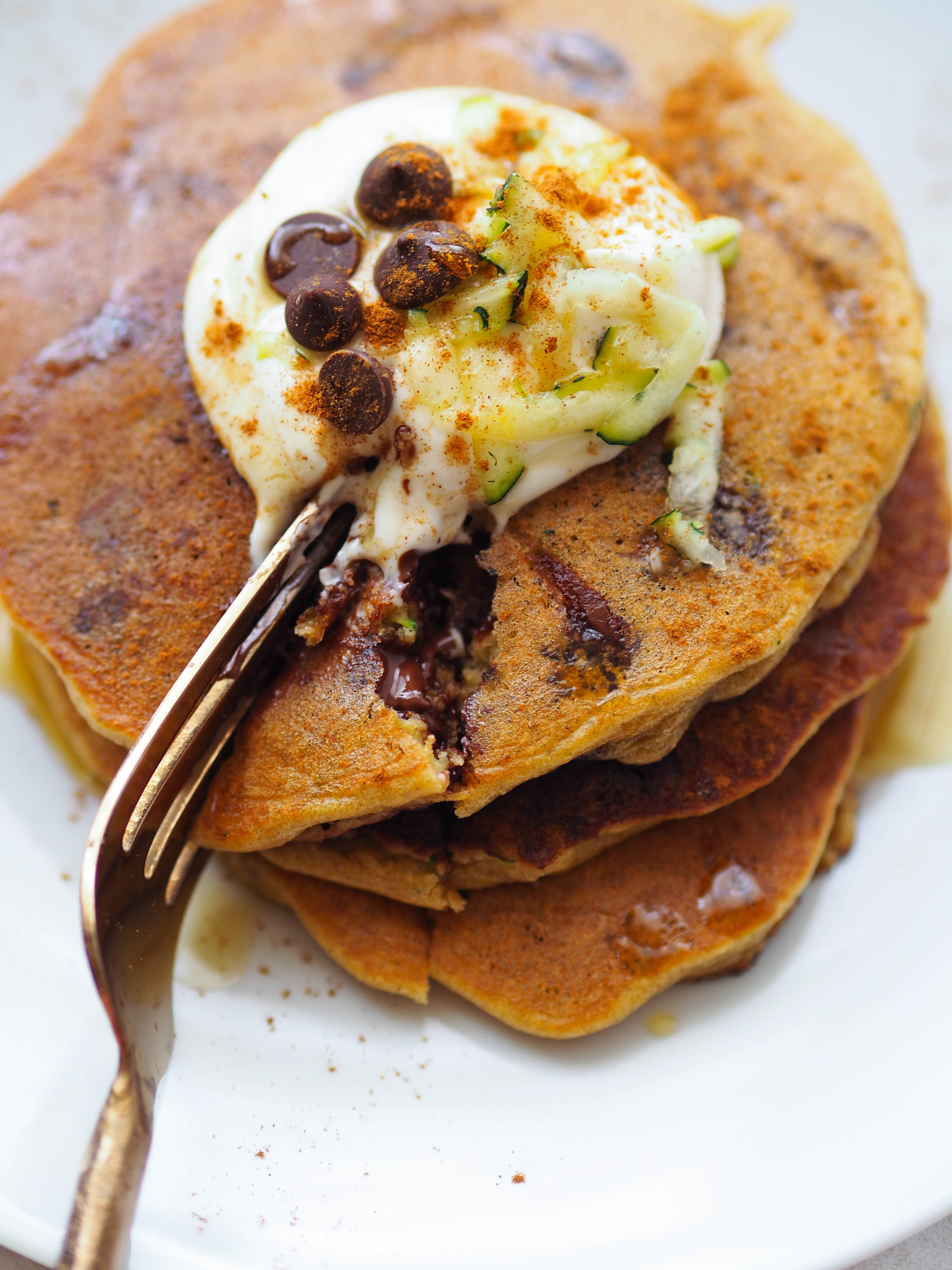 Zucchini bread in pancake form, plus dark chocolate chips! Make these almond flour zucchini bread chocolate chip pancakes, topped with a maple Greek yogurt topping! #breakfast #pancake #chocolate #glutenfree #grainfree #brunch #healthyrecipe