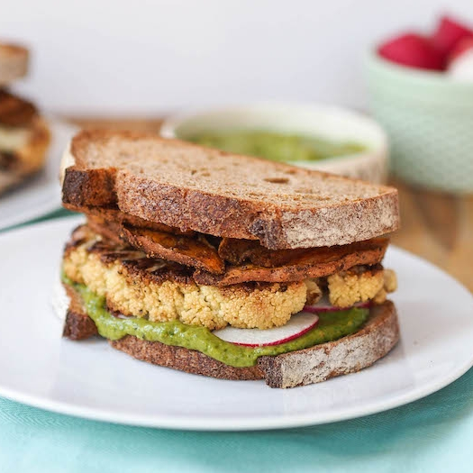 Roasted Cauliflower Sandwich with Creamy Cilantro Sauce and Spicy Sweet Potato Chips