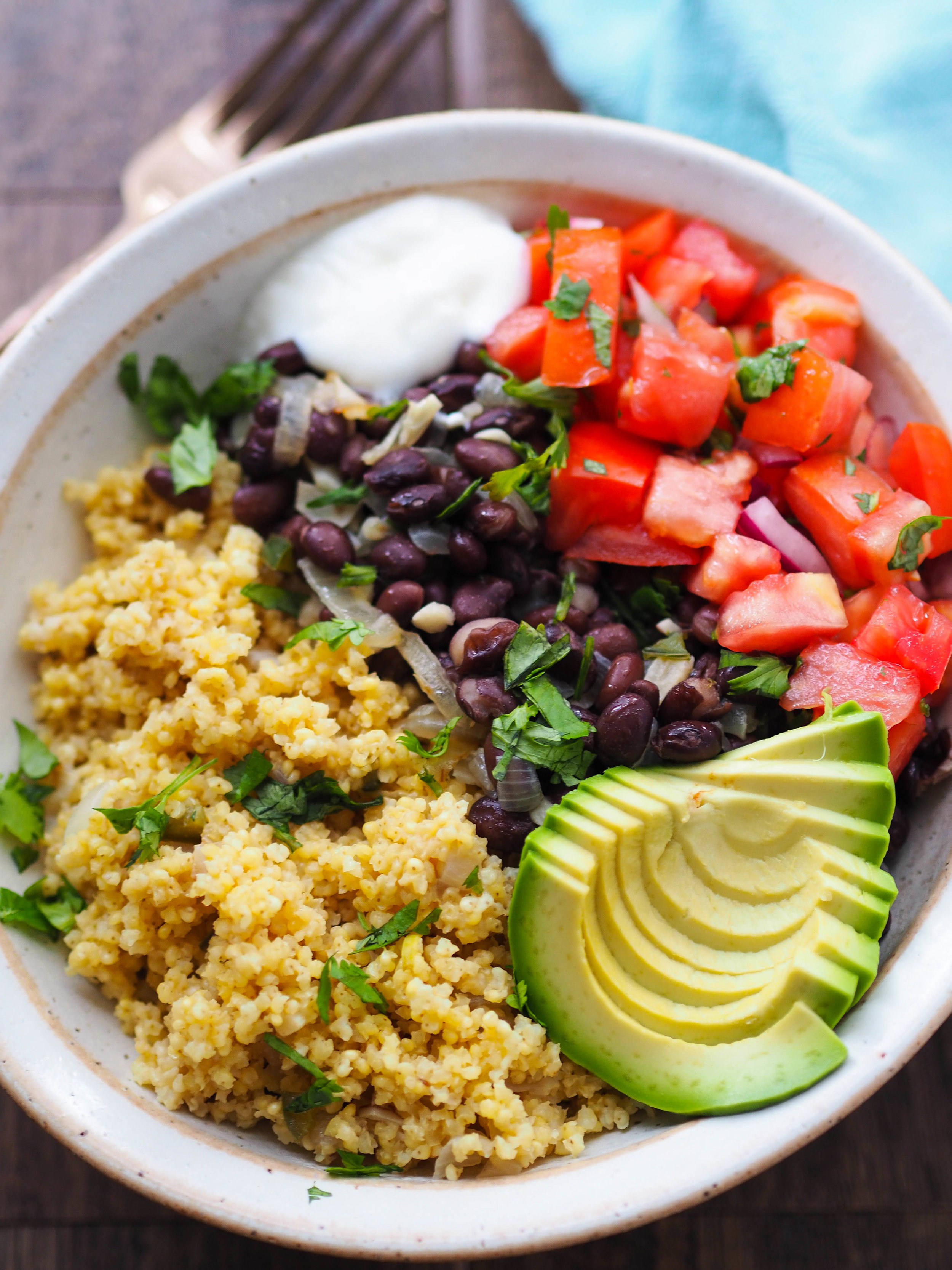 Make this easy millet bowl with black beans and pico de gallo for lunch! It's packed with filling fiber and protein! Jazz it up with extra veggies or hot sauce! #vegetarian #vegan #brainbowl #millet #blackbeans #avocado #healthyrecipe #glutenfree