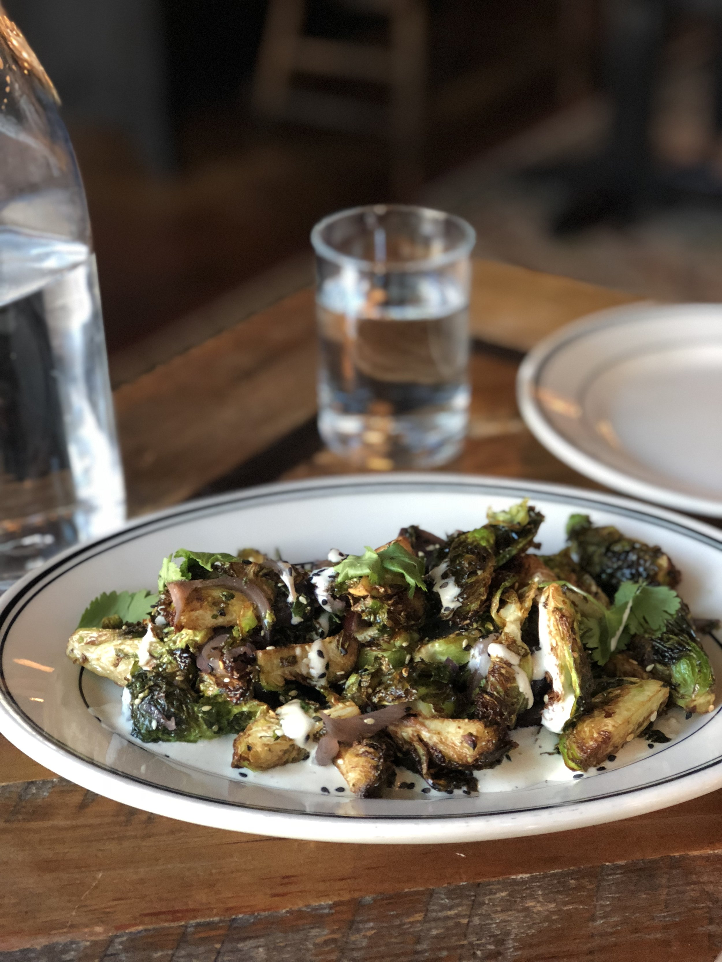 Fried Brussels sprouts with roasted red grapes and tahini