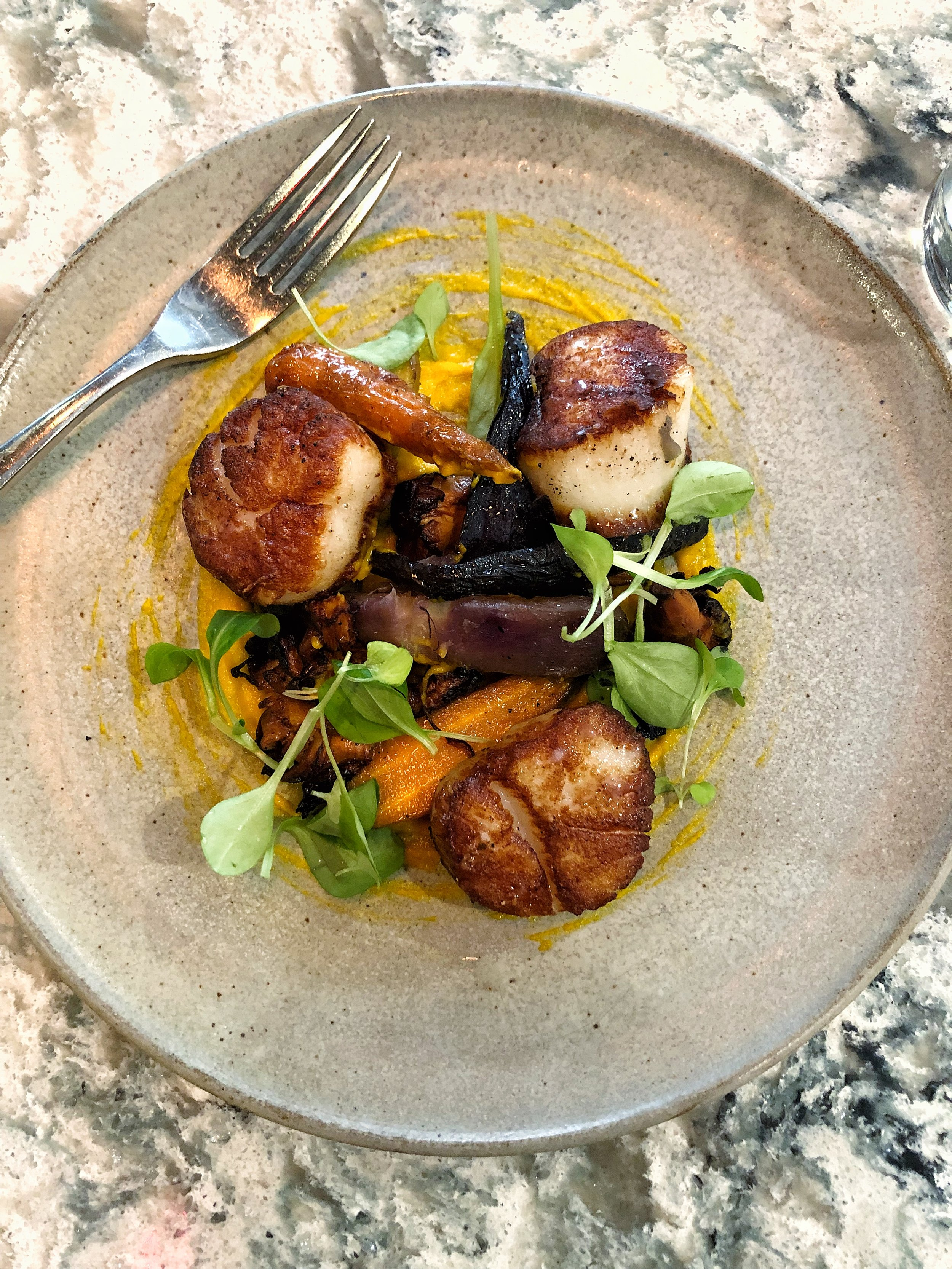 Seared scallops with carrot cream, roasted carrots, and chanterelles