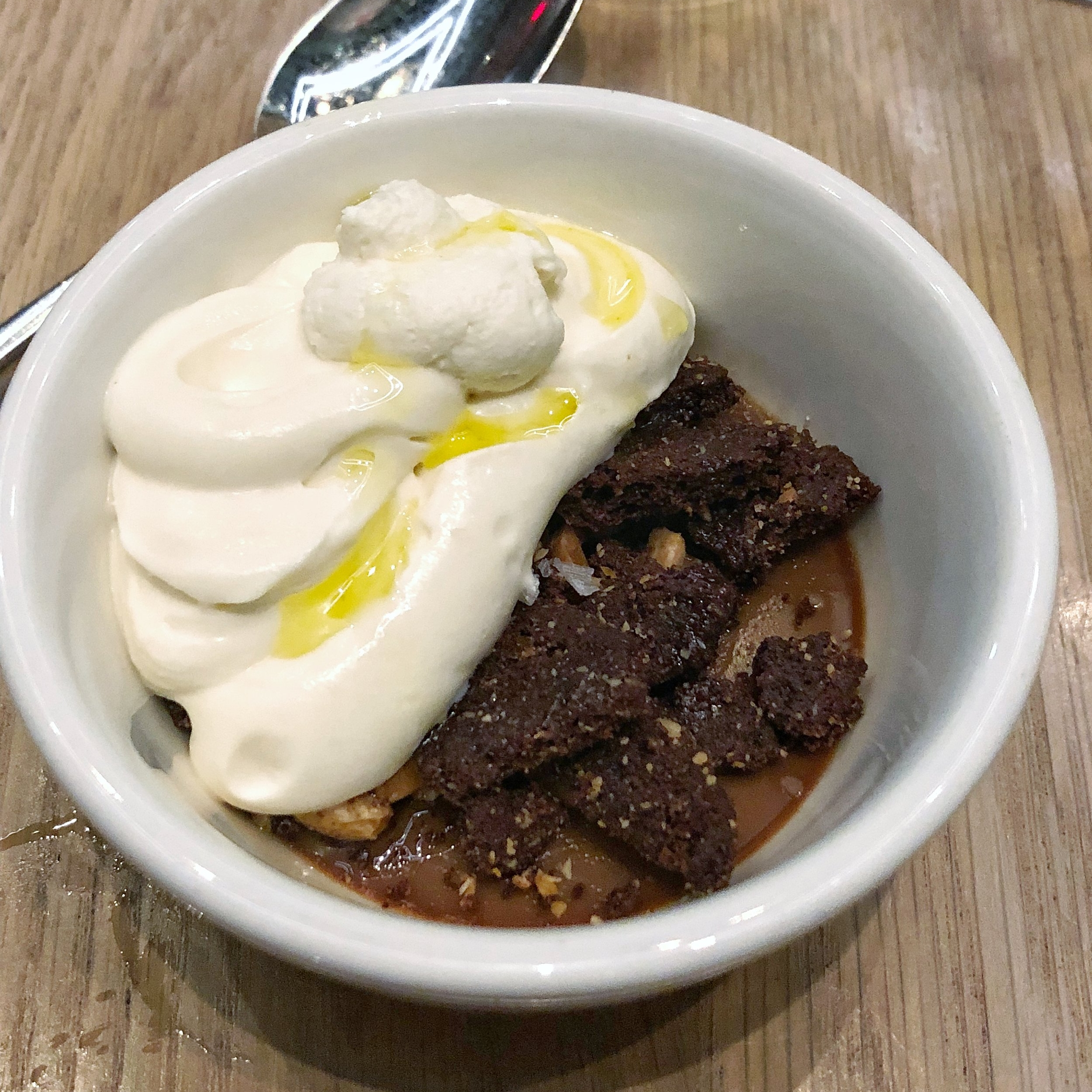 One of the BEST desserts I've ever had - a coffee chocolate custard with fermented whipped cream, sea salt, and olive oil
