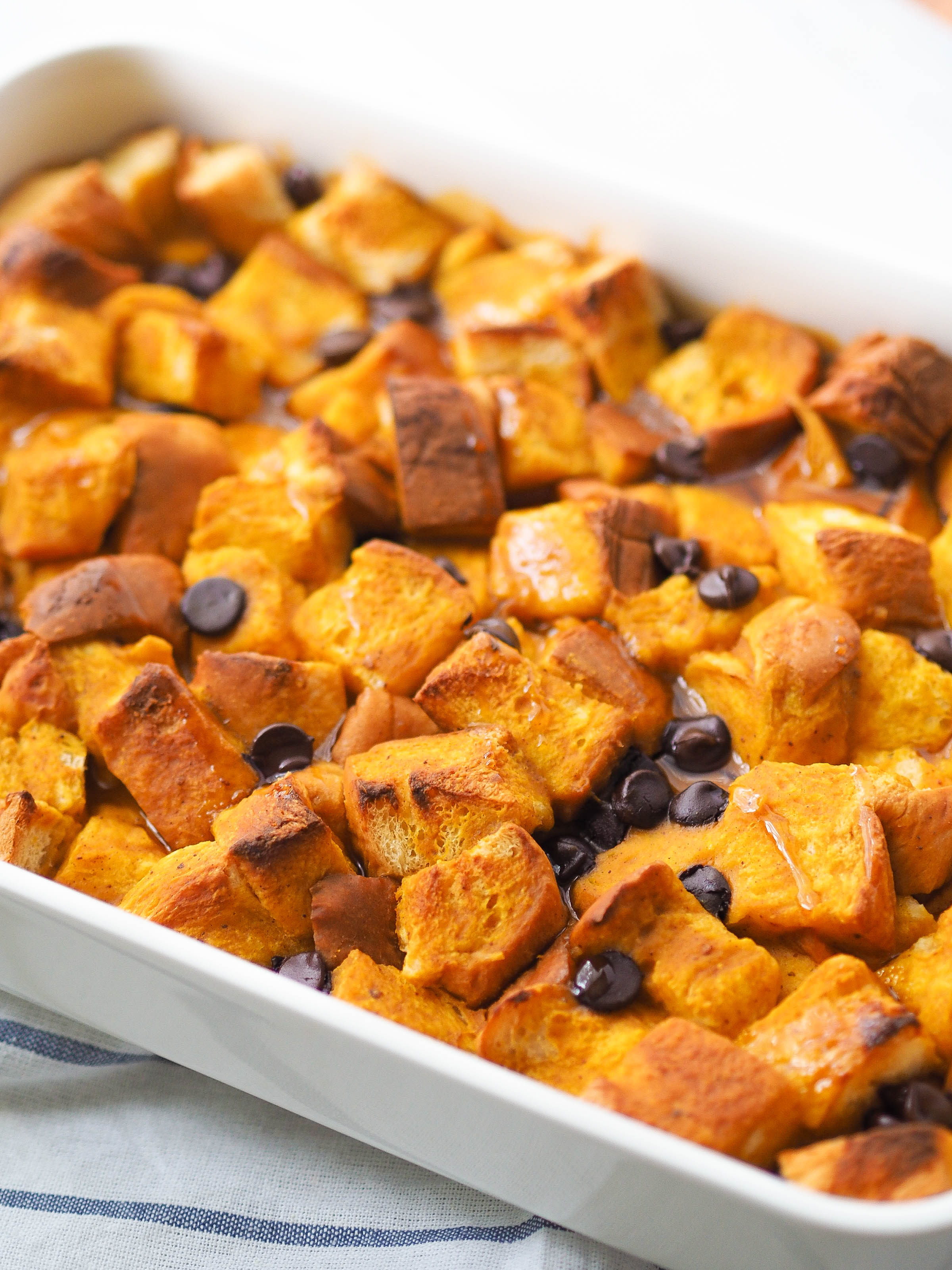 Move over pie! Make this pumpkin coconut dark chocolate chunk bread pudding for Thanksgiving! #thanksgiving #breadpudding #pumpkin #dessert #chocolate