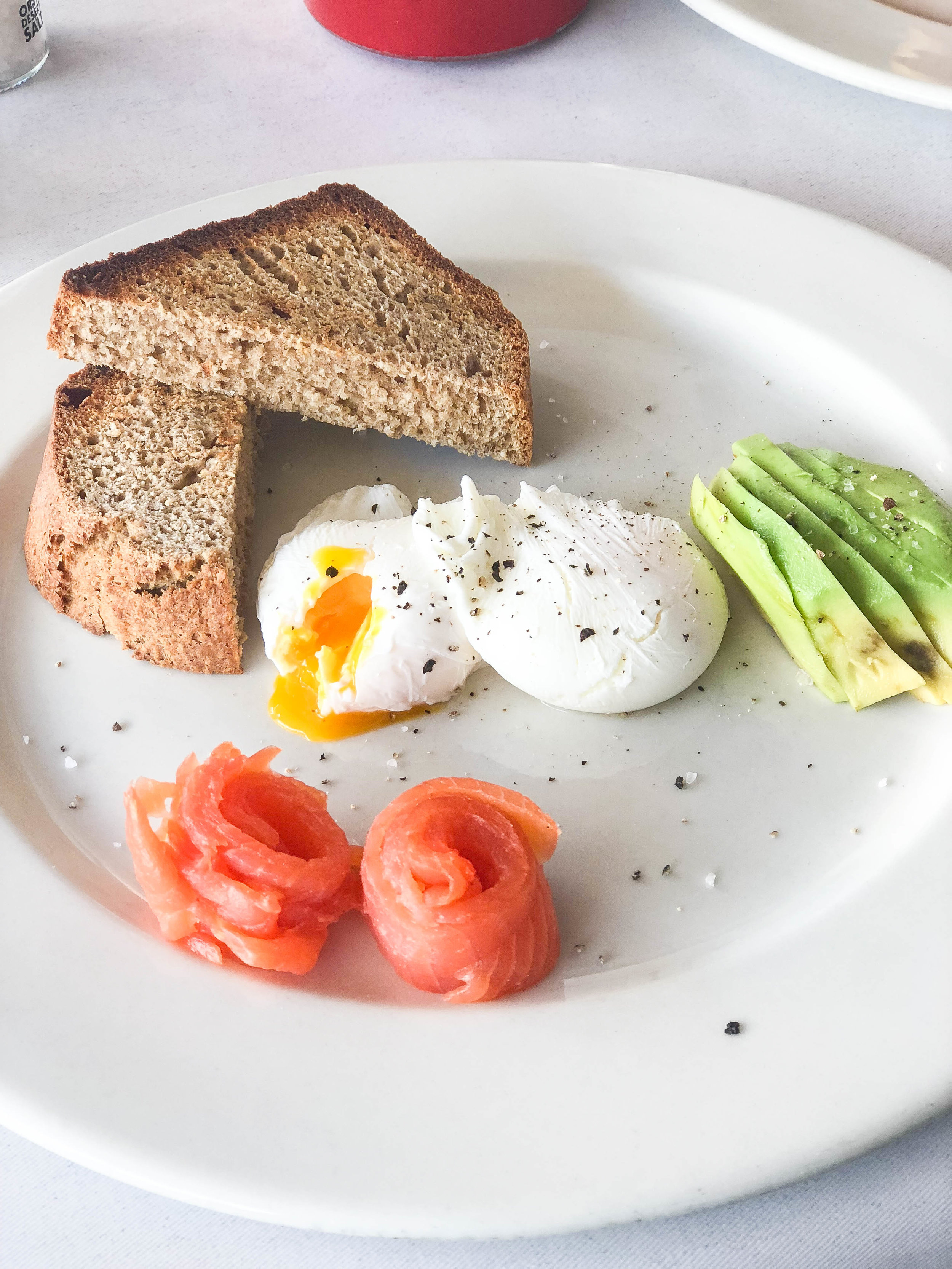 Coconut bread with poached eggs, avocado and smoked salmon