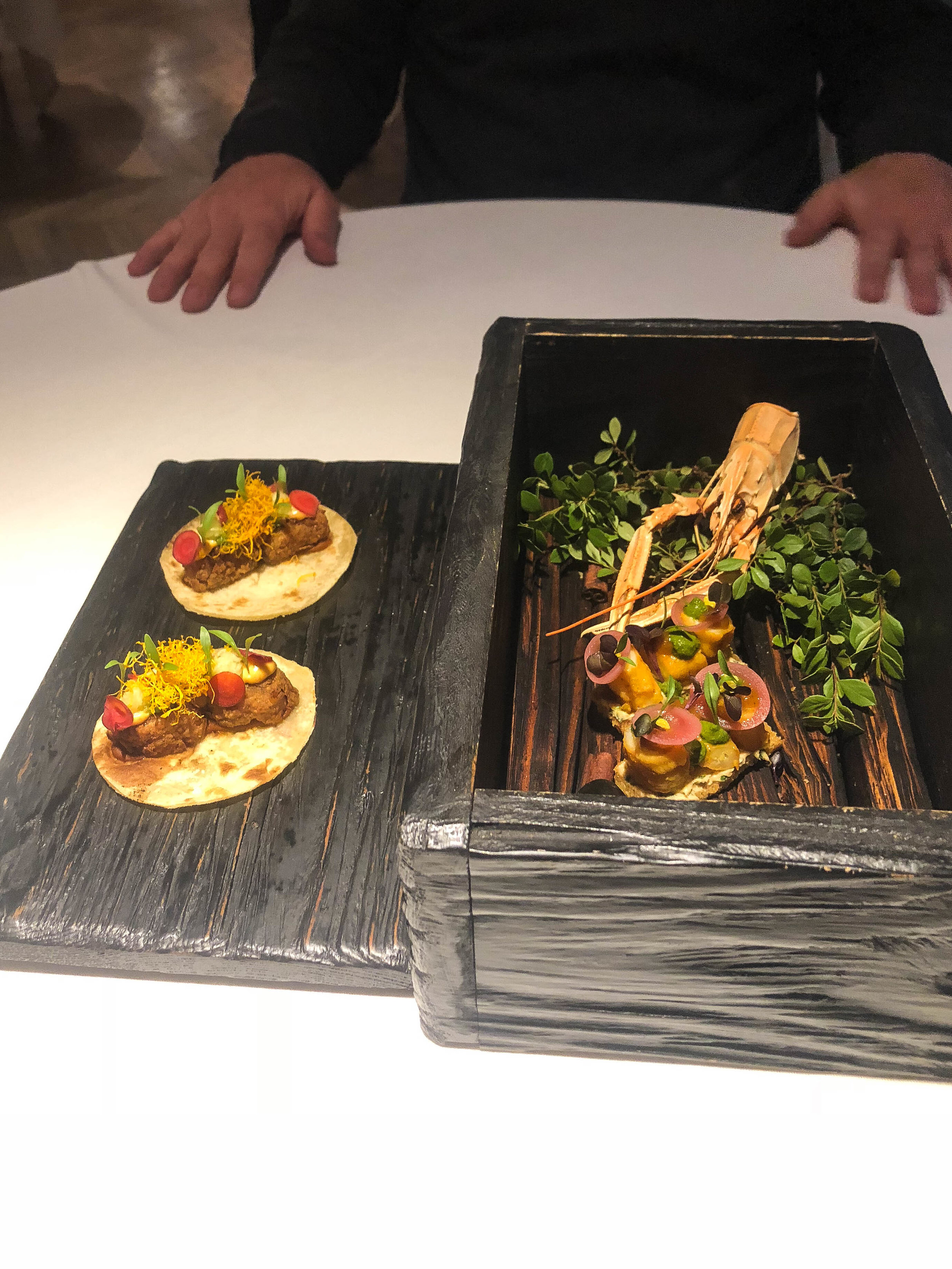 """Started with Cape Malay snacks that were served in this wooden box filled with smoke. """"Tacos"""" with Cape Malay spiced chicken meatballs and prawn crisps with curry aioli"""