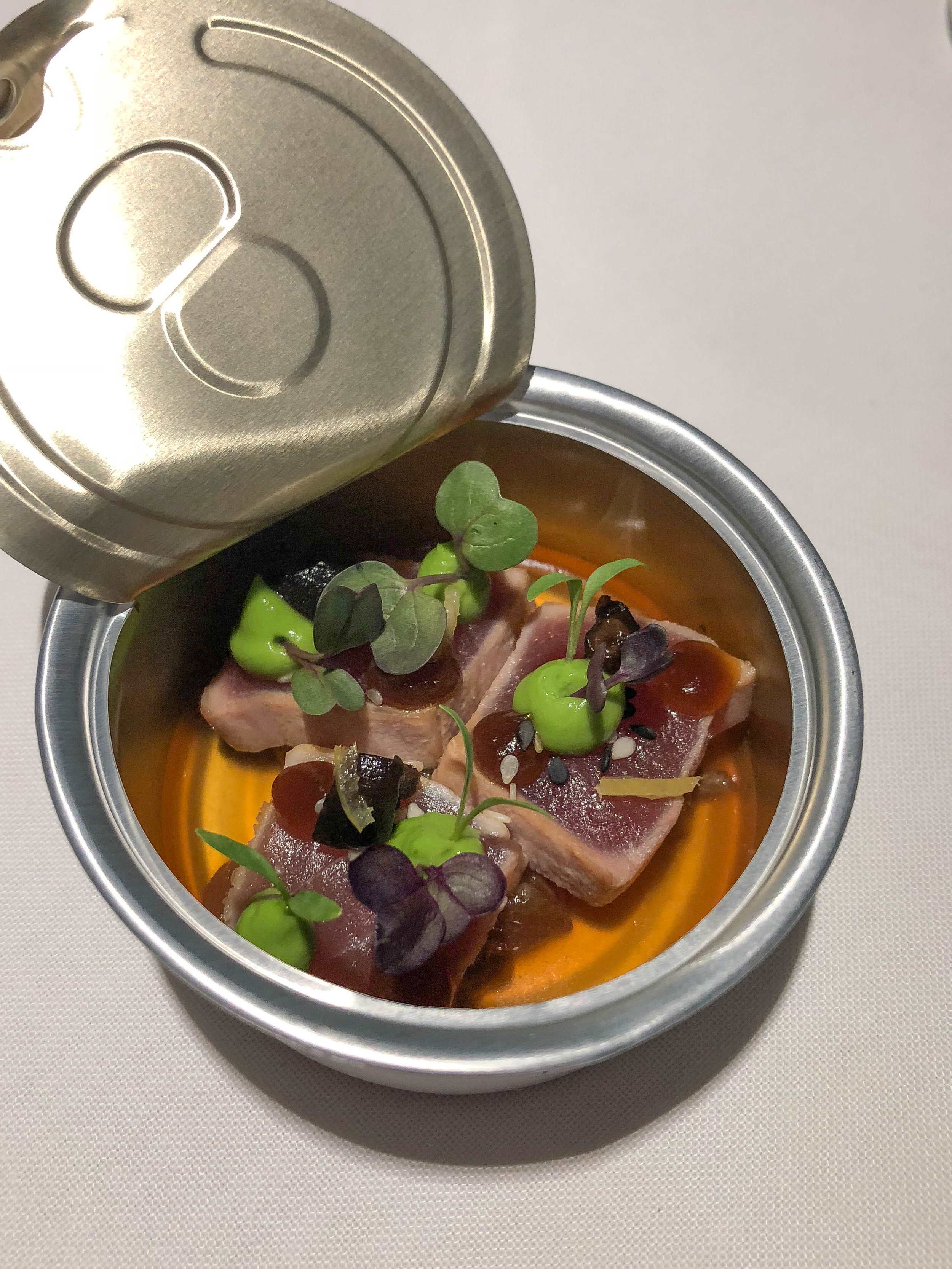 La Colombe's famous tuna dish. You're served a can of tuna, which you open up to find slices of perfectly seared raw tuna topped with wasabi cream, sesame, and an umami broth. I'd say it's like magic but my packaging science husband explained how they do it.