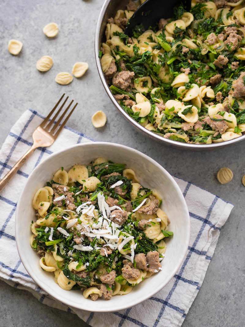 Mustard Green and Sausage Orecchiette! Just seven ingredients to make this easy, family friendly meal! #pasta #healthyrecipe #mustardgreens #greens #easyrecipe