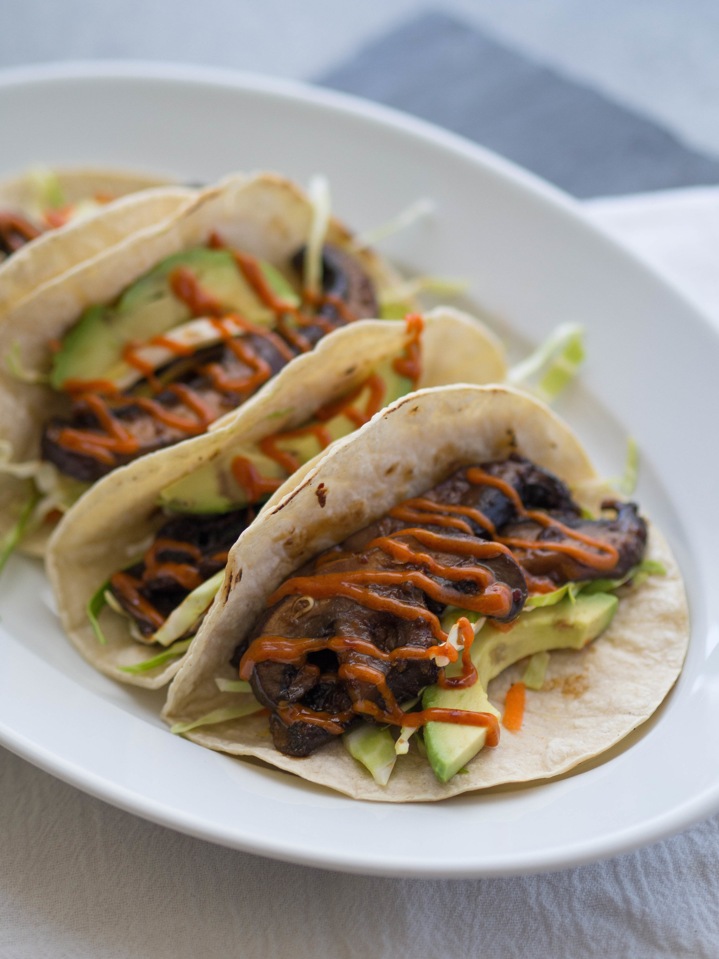 A vegan take on bulgogi tacos! These bulgogi portobello tacos are filled with avocado and a spicy gochujang mayo! #vegan #vegetarian #taco #bulgogi #mushroom #avocado #healthyrecipe
