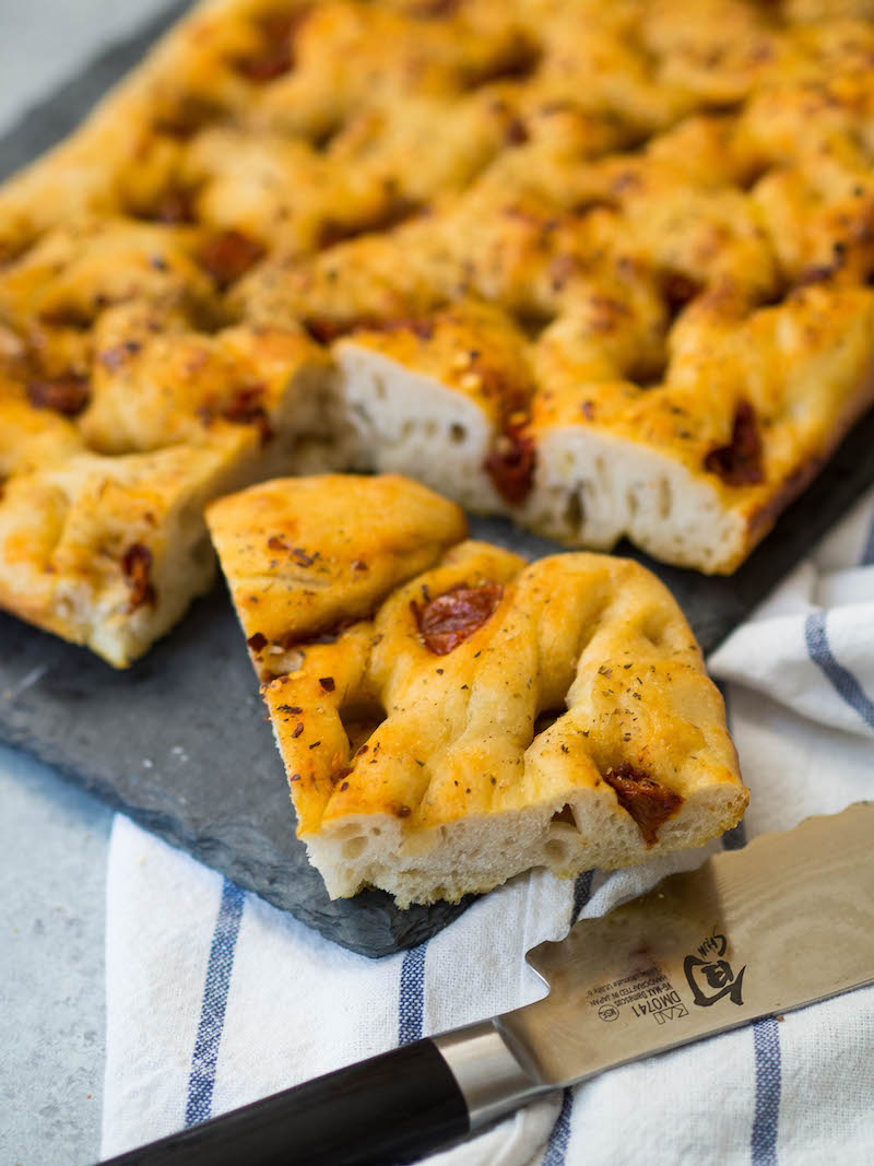Easy No-Knead Focaccia with Roasted Garlic and Dried Tomatoes! It's such a simple recipe that takes a little bit of hands off time and hardly any effort! #bread #baking #focaccia #easyrecipe #italianfood
