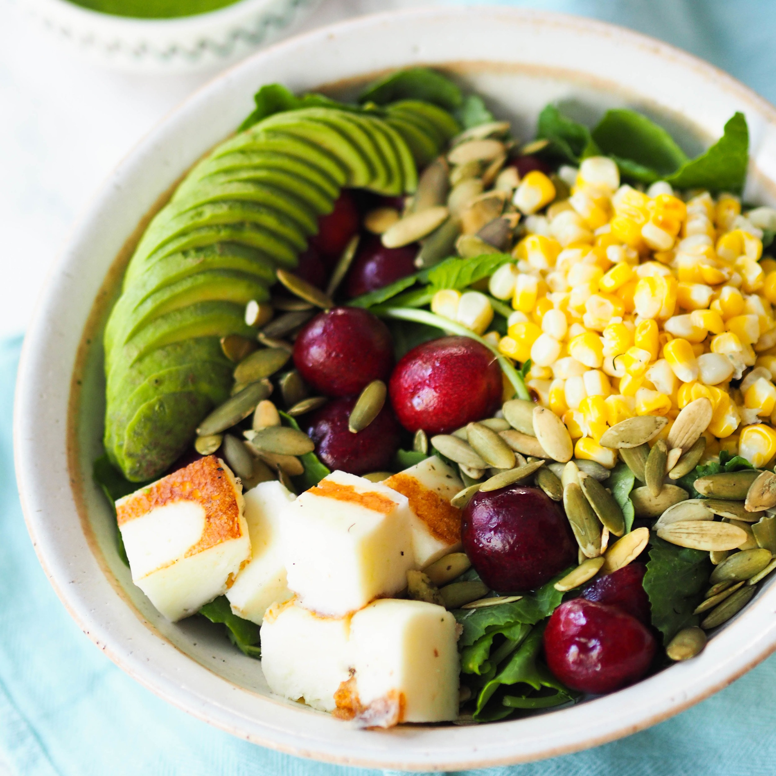 Baby Kale Salad with Grilled Halloumi, Cherries and Corn