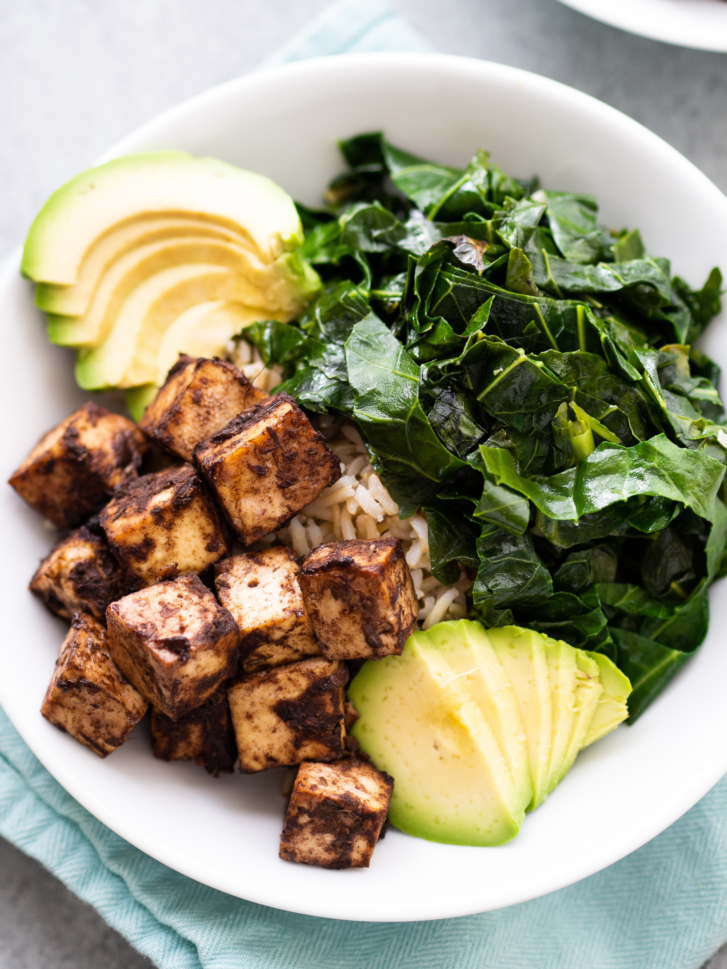 the jerk tofu bowl is full of flavor and bold jerk spices #vegetarian #tofu #grainbowl #healthydinner #healthyfood #bowlrecipe