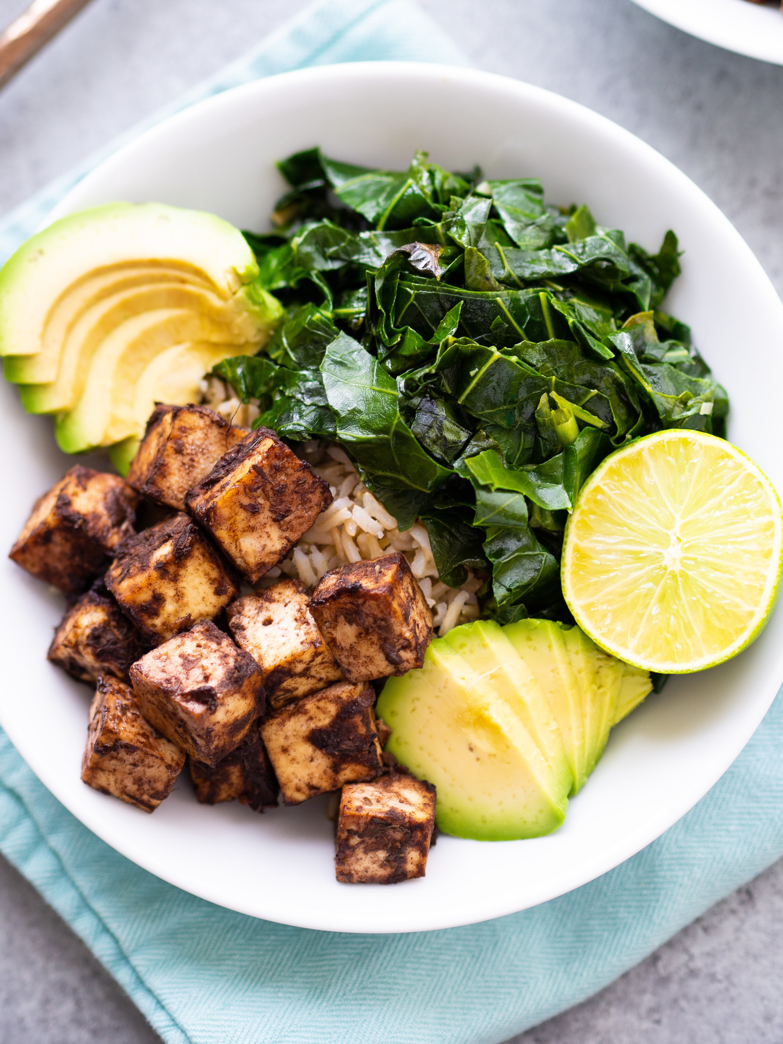 the easy jerk tofu bowl is great with collards or other greens #vegetarian #tofu #grainbowl #healthydinner #healthyfood #bowlrecipe