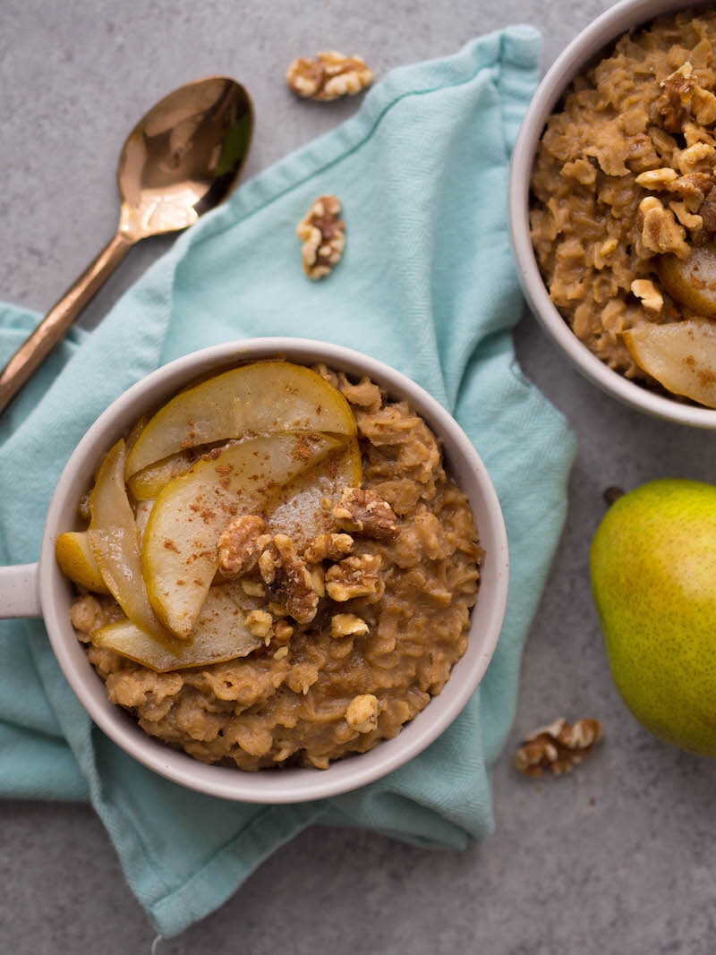 Chai Oatmeal with Spiced Sauteed Pears is the coziest winter breakfast! Cook rolled oats in chai infused almond milk, and top with syrupy spiced pears! #breakfast #oatmeal #glutenfree #chai #healthybreakfast #vegetarian #walnut