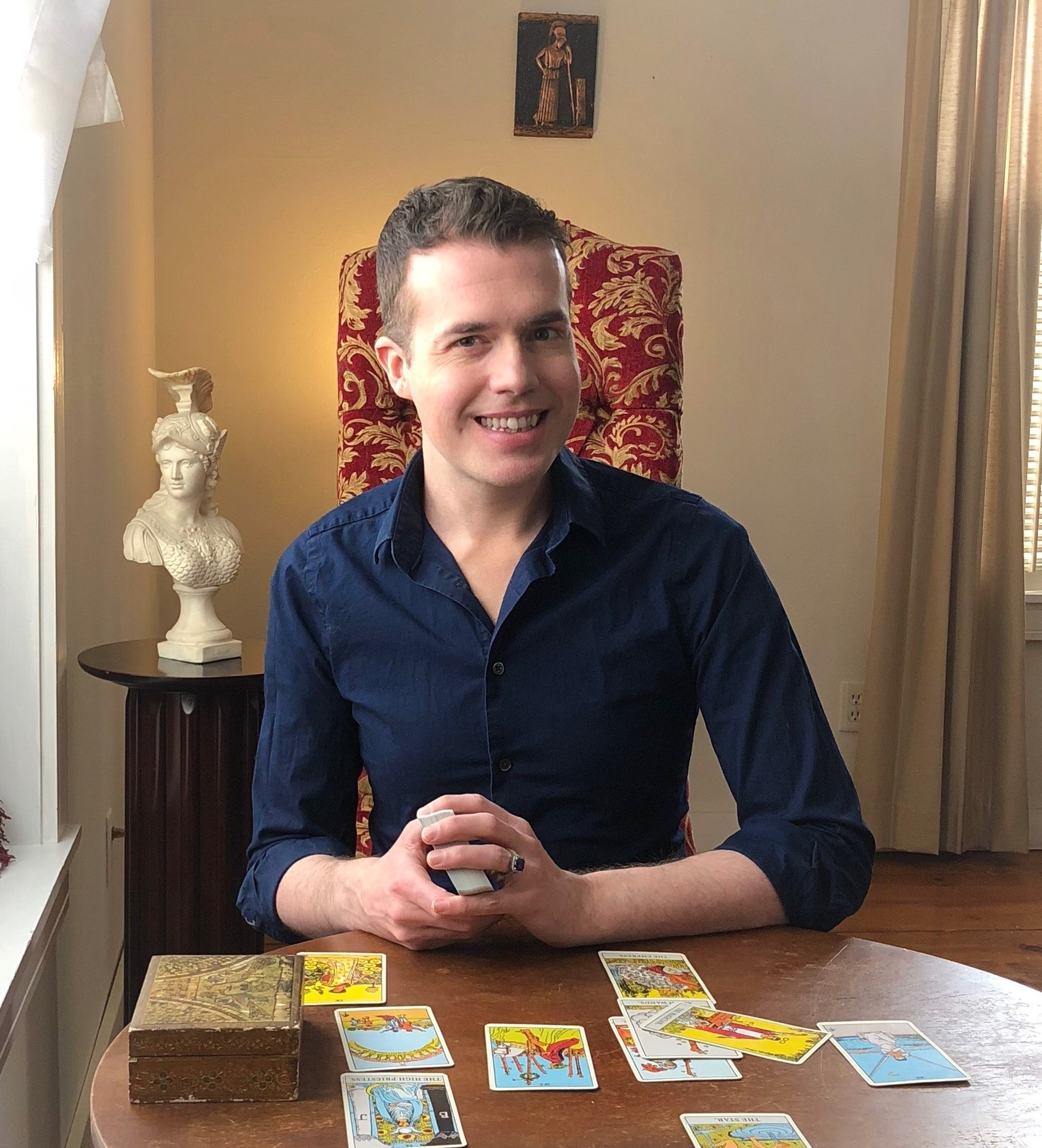 Meet Elliot - Dr. Elliot Adam is a tarot specialist originally from the Metro-Milwaukee area. He currently operates the tarot website ElliotOracle.com, providing readings for clients from all over the world. From 2000-2005, he owned Athena's Oracle, a divination specialty shop, located in the heart of Milwaukee's historic East-Side. For over twenty years, Elliot has performed thousands of readings. He is known for his empowering, clear, and remarkably accurate consultations. Aside from tarot, Elliot's interests include ancient Greek language, religion, history, and classical music. In 2016, he earned his doctoral degree in classical oboe.