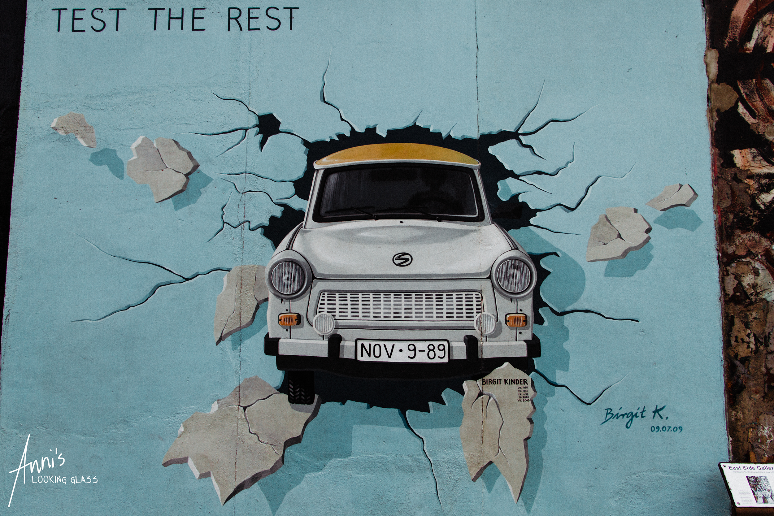 A little Trabi - the typical East German car - breaks through the Iron Curtain completely unscathed.