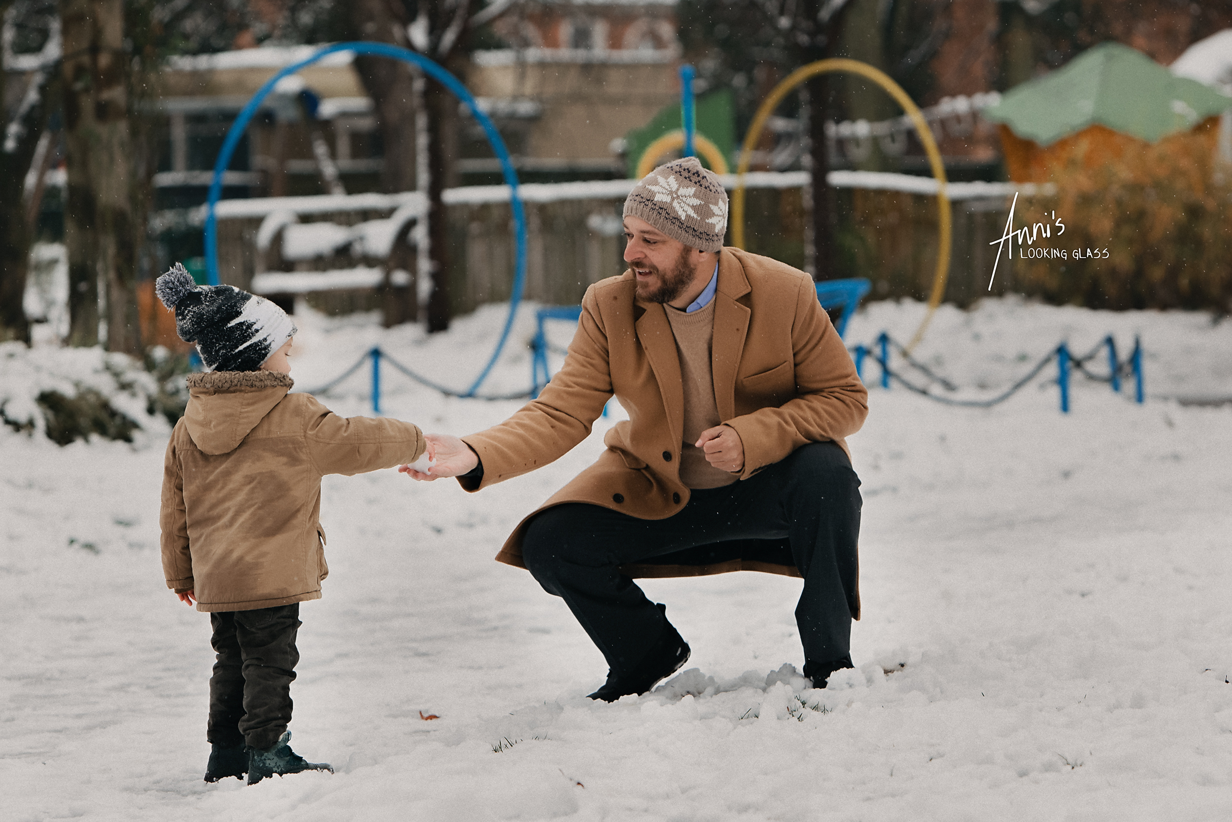 A father and his young son playing with the snow in Queens Park Loughborough