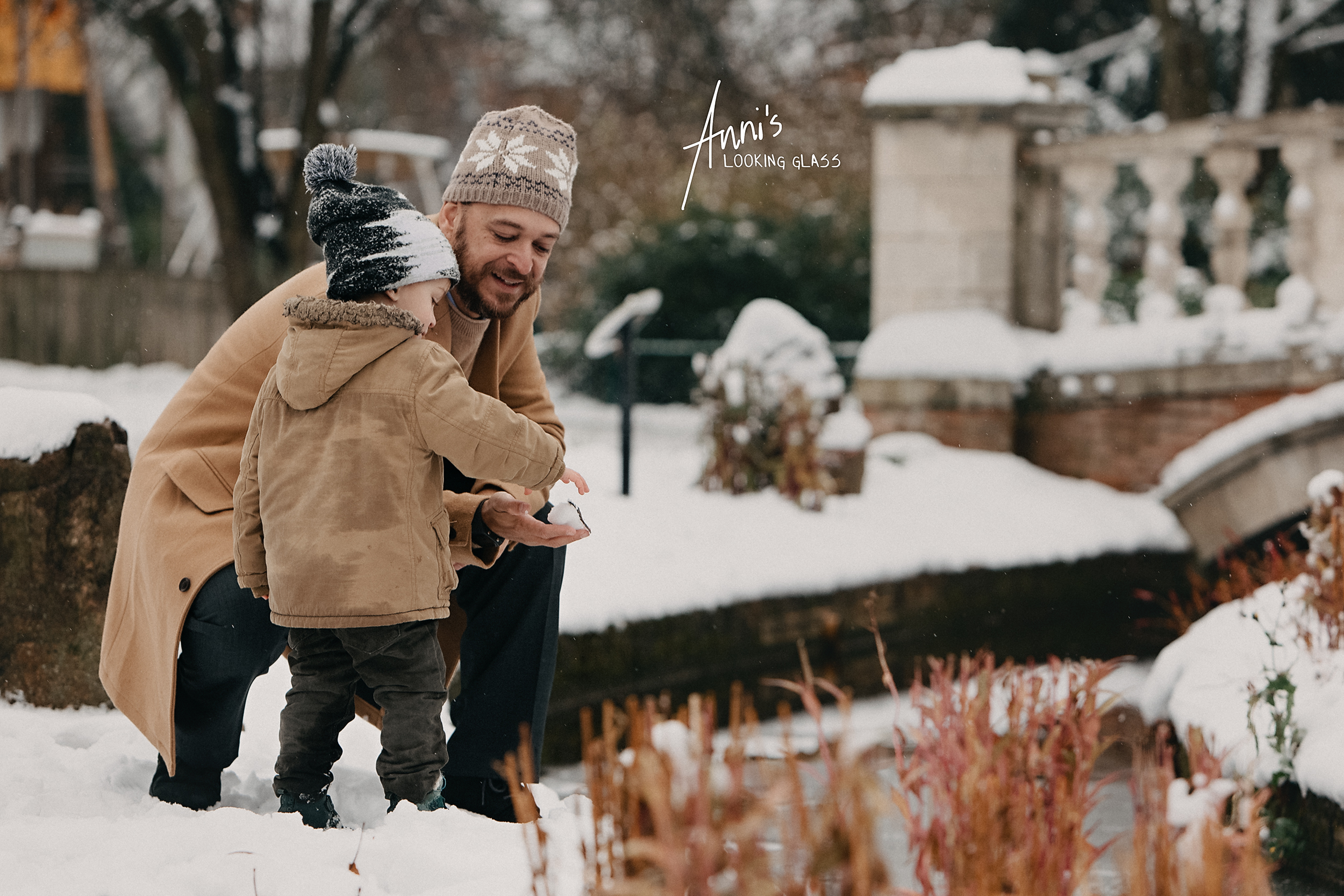 A father and his young boy playing with the snow in Queens Park Loughborough